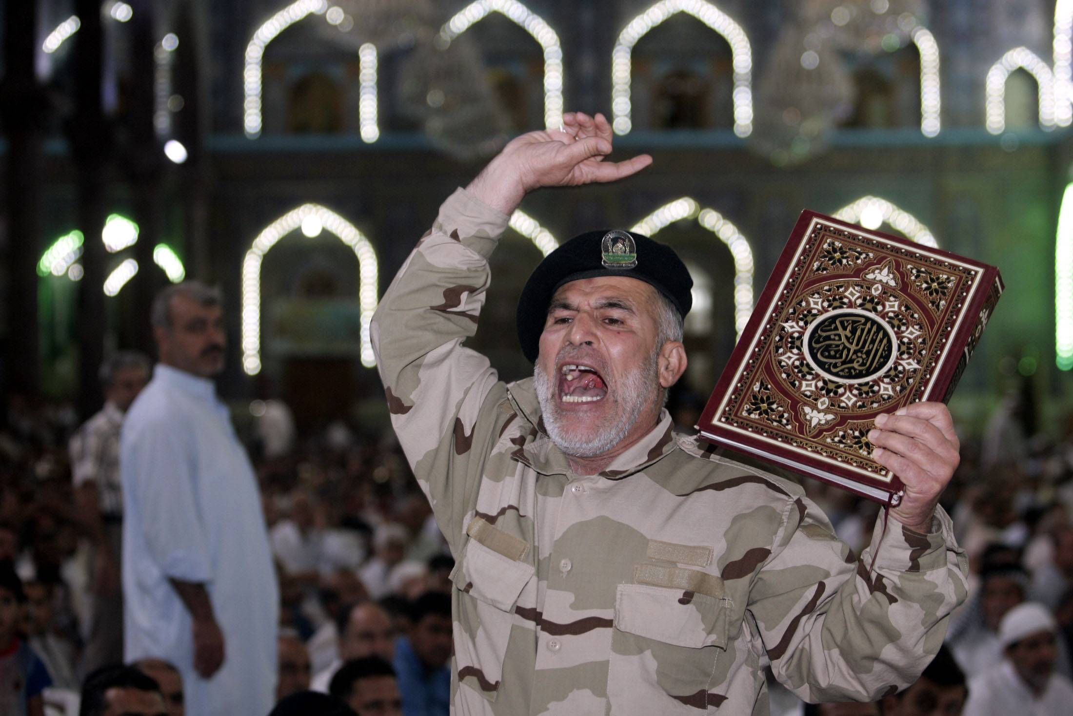 An Iraqi Shiite fighter chants slogans against the al-Qaida-inspired Islamic State group during Friday prayers in the Shiite holy city of Karbala, 50 miles south of Baghdad. The Sunni militant blitz led by the Islamic State extremist group has effectively cleaved the country along ethnic and sectarian lines -- the swath of militant-held Sunni areas, the Shiite-majority south and center ruled by the Shiite-led government in Baghdad and the Kurdish north.