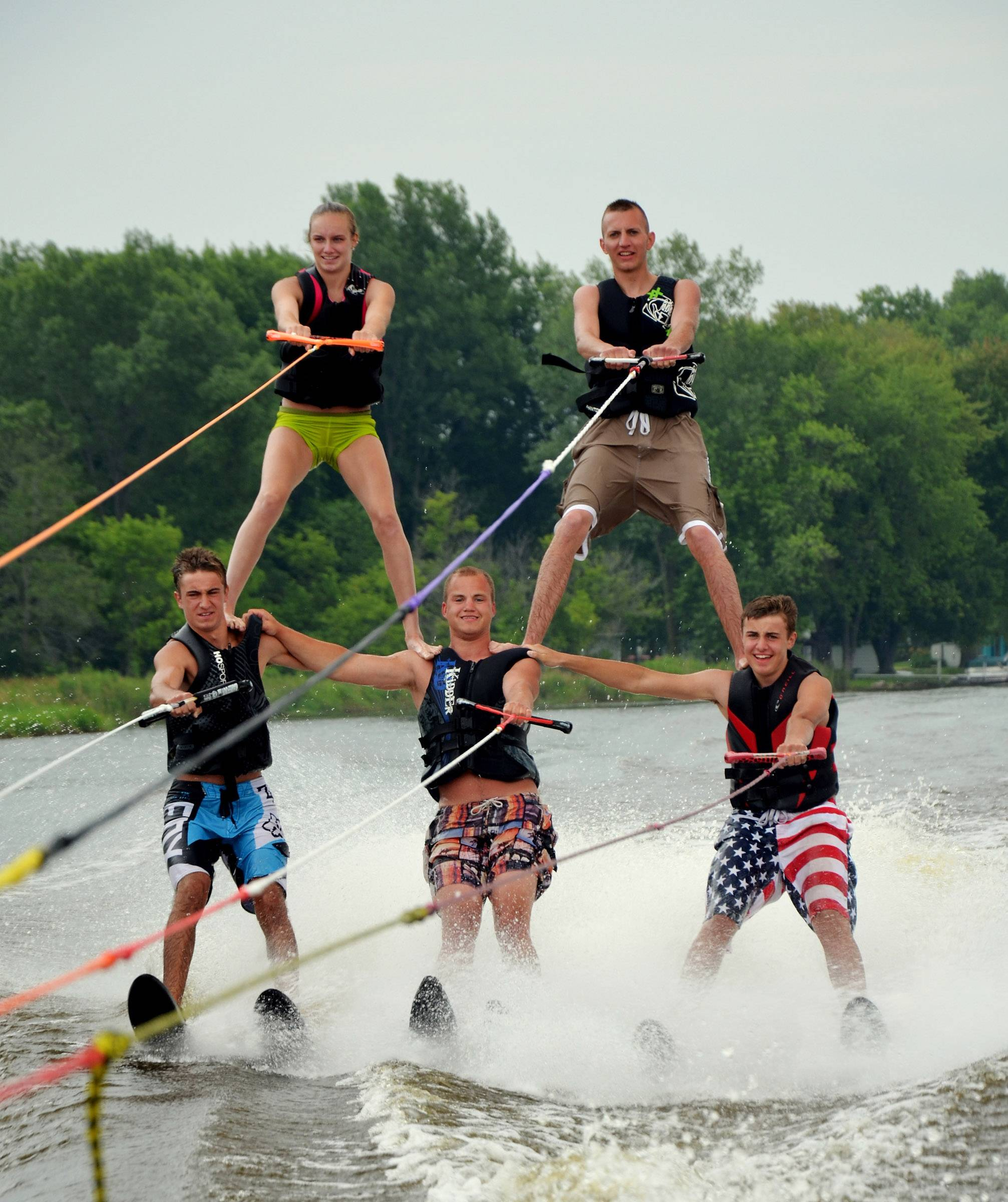 Friends Alex Tinaglia, Jimmy Tinaglia, Nick Tinaglia, Connor Solum and Mike Kintzle form a five-man pyramid on water skis on their second attempt ever. It was quite a sight in Princeton, Wisconsin over the Fourth of July weekend.