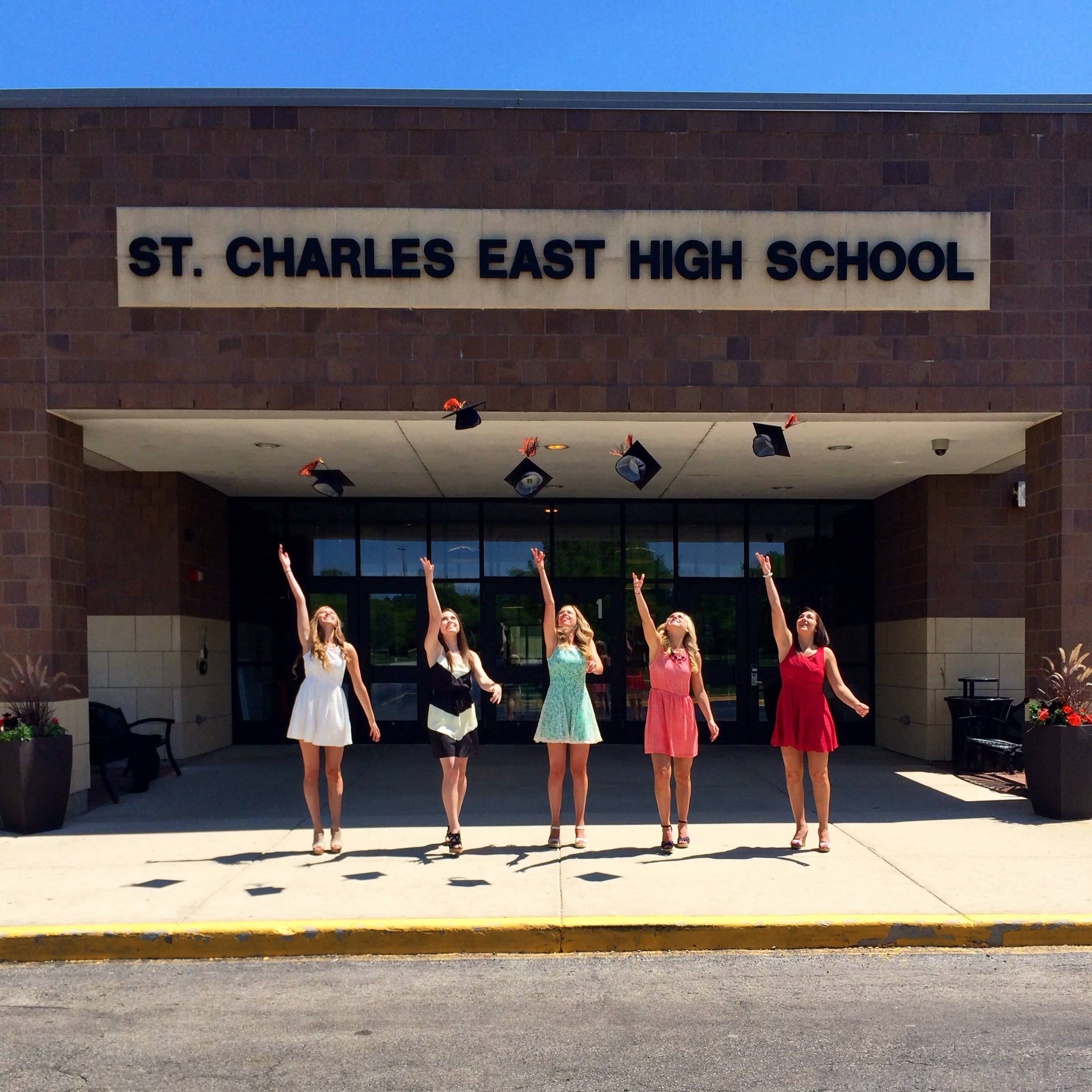 I took this picture of my daughter Nicole and her friends, Fiona, Ashley, Courtney and Cara on graduation day in front of St. Charles East High School. I love this picture because the hats show up so nicely against the white ceiling, and you can also see their shadow on the ground all in a row.