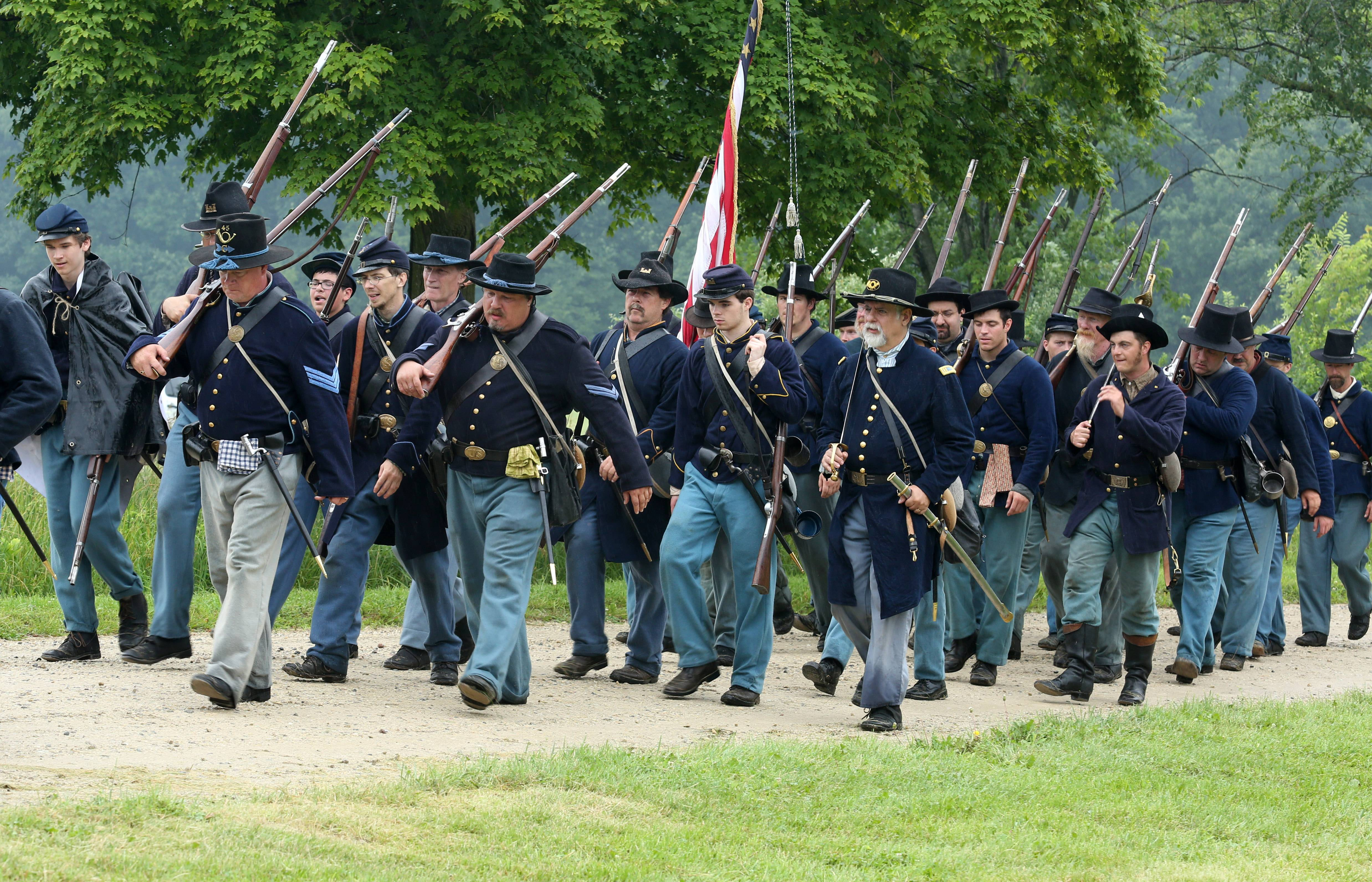 Men from the 1st Illinois battalion march through Lakewood Forest Preserve during the 23rd annual Civil War Days on Saturday near Wauconda.