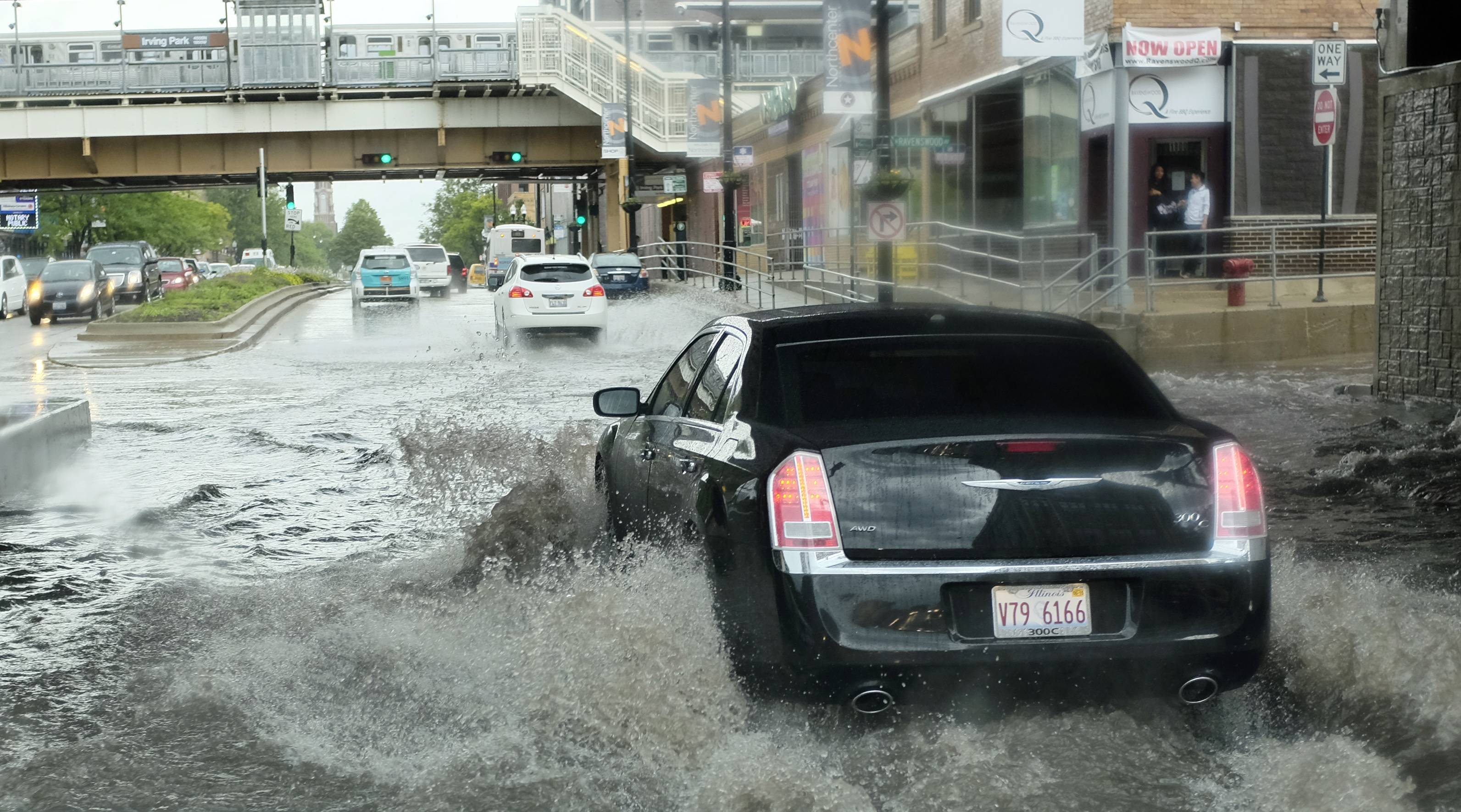 A car drives through a flooded street Saturday in Chicago.