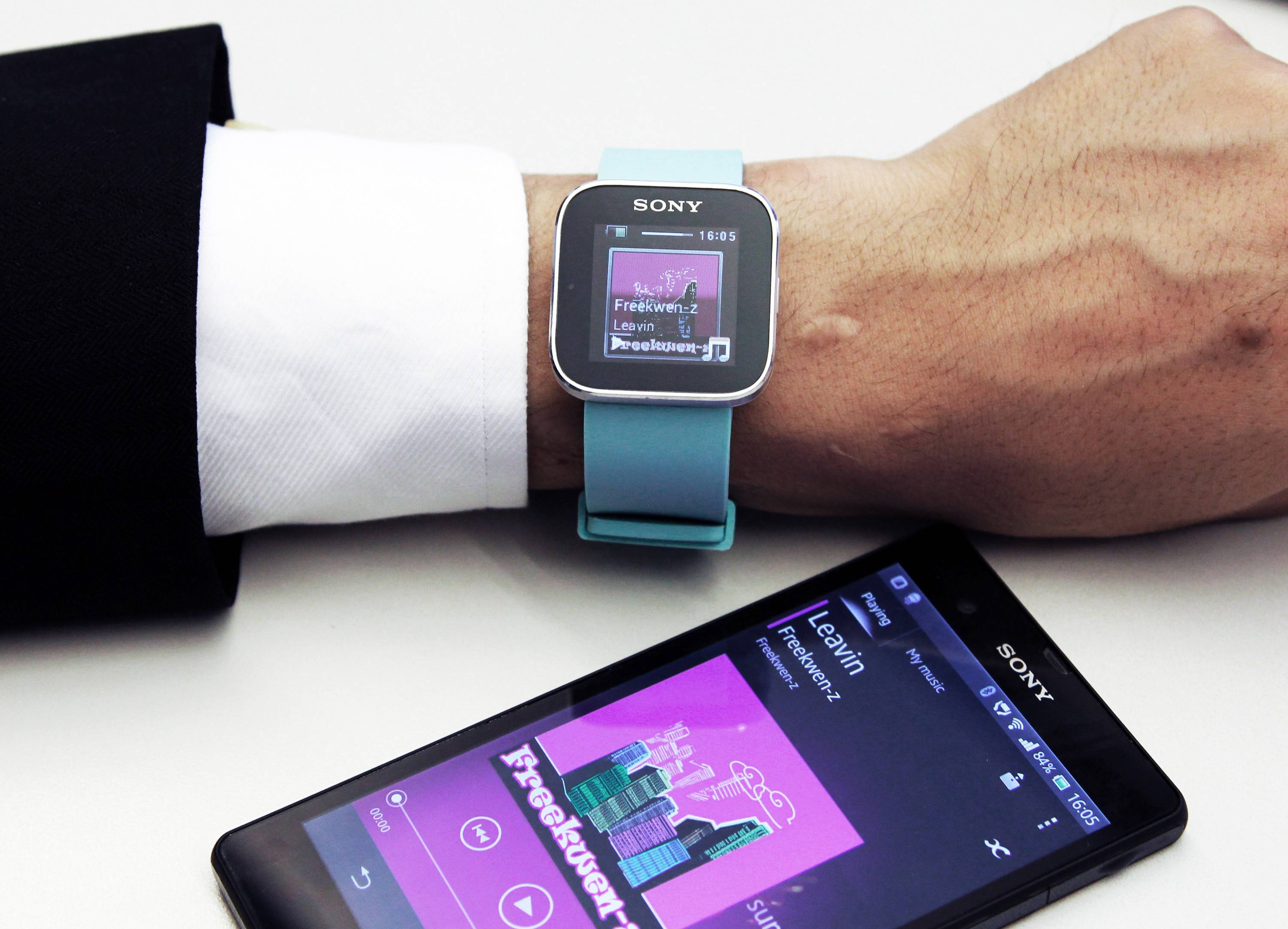 A Sony Mobile Communications Inc. SmartWatch MN2, top, is displayed with the company's Xperia smartphone at the Sony Corp. headquarters in Tokyo, Japan.