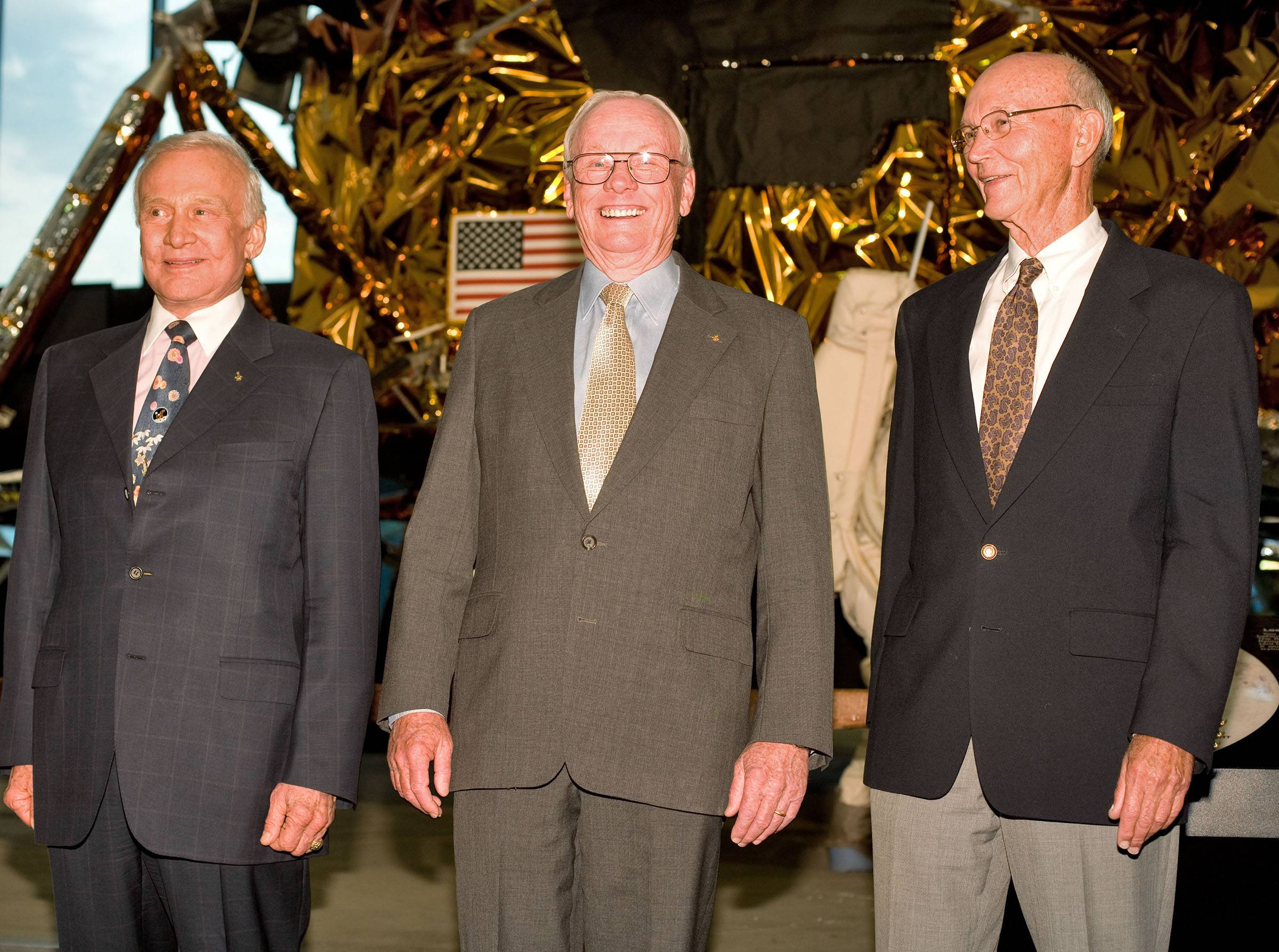 Buzz Aldrin, left, Neil Armstrong and Michael Collins, pose for a photograph in front of the Apollo 11 lunar module at the Smithsonian National Air and Space Museum in Washington on July 19, 2009. That year they also met with President Barack Obama in the White House, continuing a tradition.