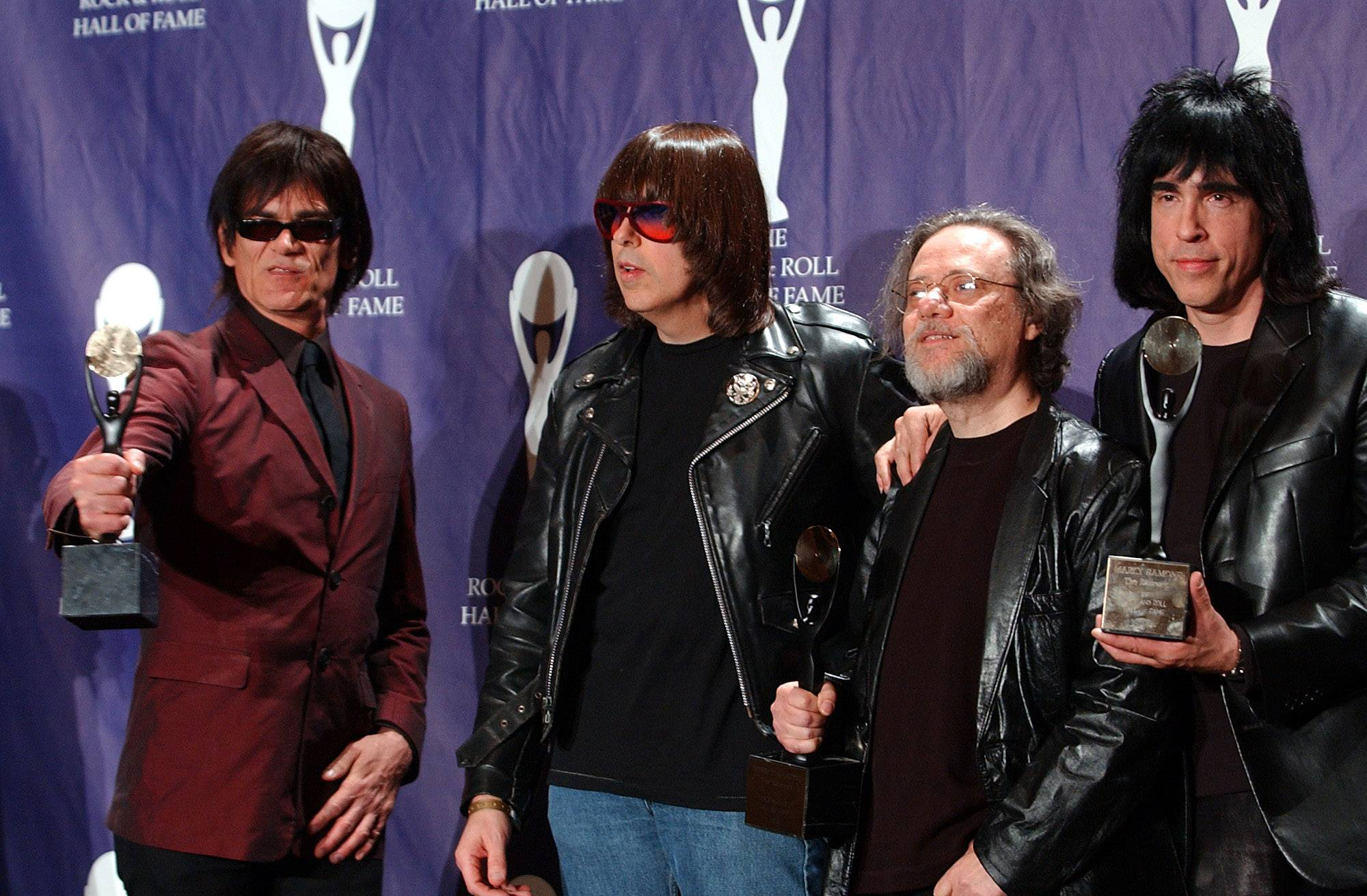 Members of the Ramones, from left to right, Dee Dee, Johnny, Tommy and Marky Ramone hold their awards after being inducted at the Rock and Roll Hall of Fame induction ceremony on March 18, 2002, at New York's Waldorf Astoria. A business associate says Tommy, the last surviving member of the original group, died on Friday, July 11.