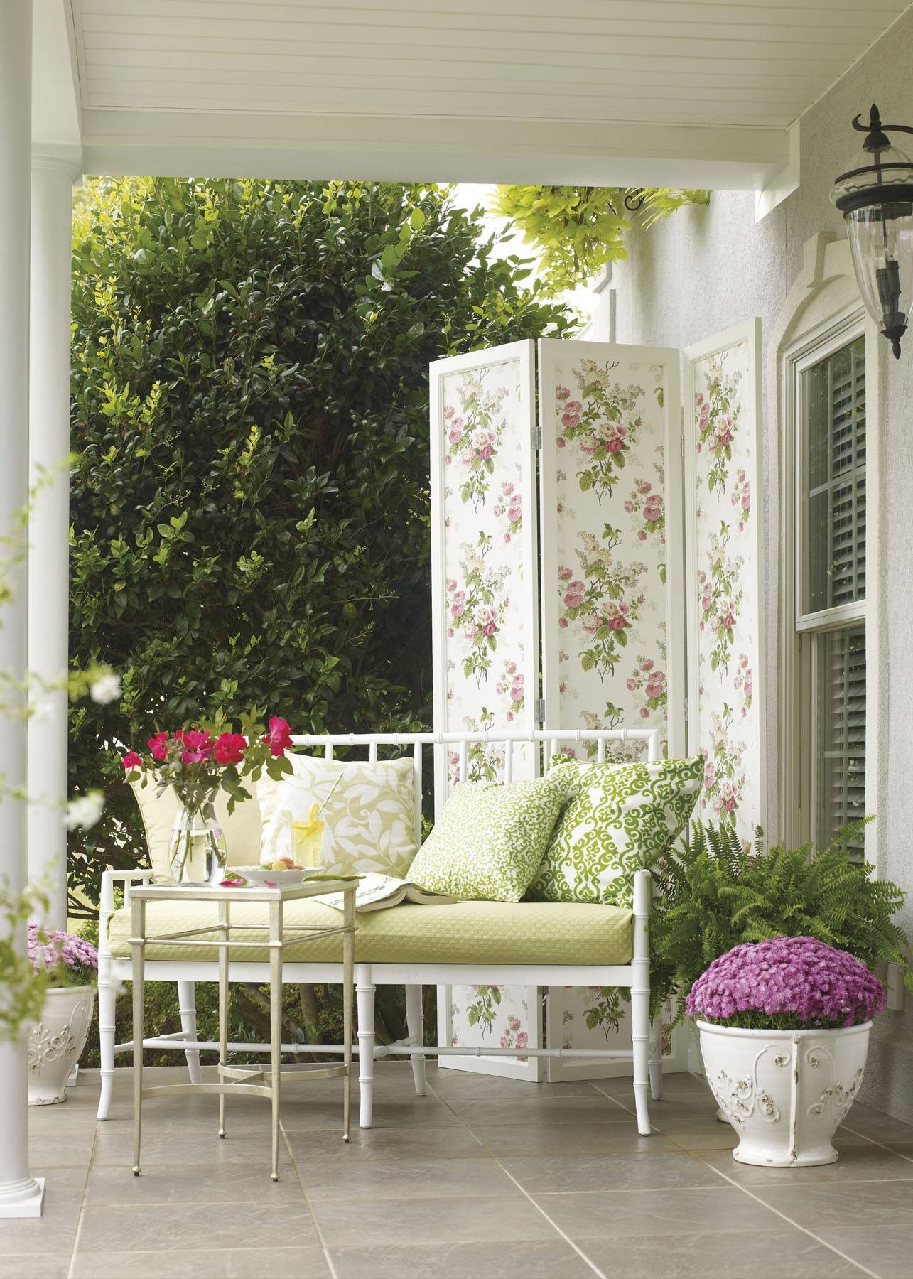 A flower-inspired wallpapered screen politely blocks the neighbor's view.