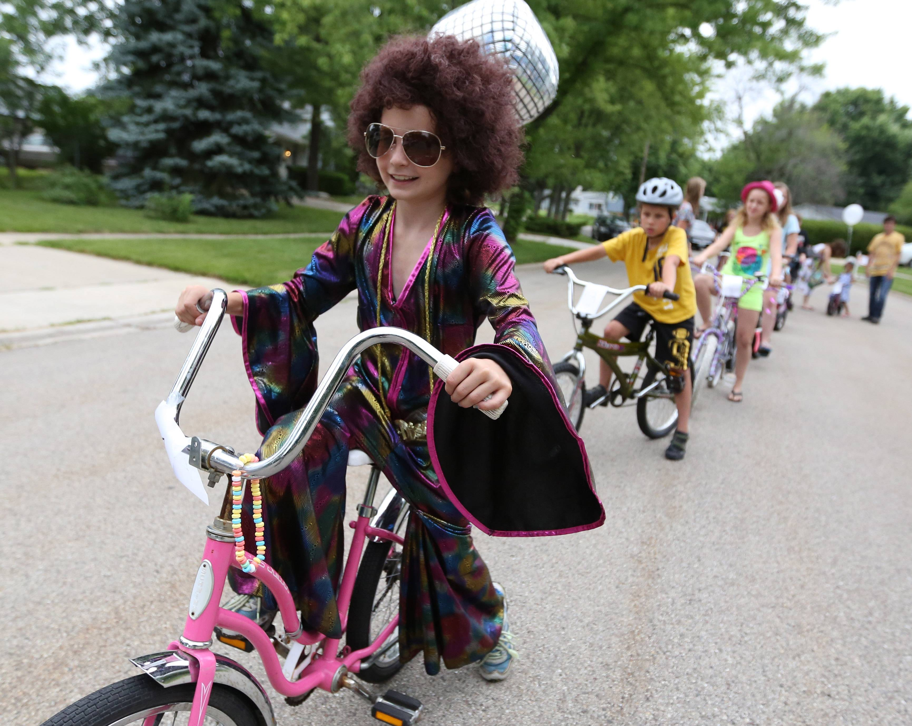 Gia Ruffolo, 8, of Grandwood Park leads a judged kids bike parade Saturday near Adams Park as part of the Grandwood Park Summerfest.