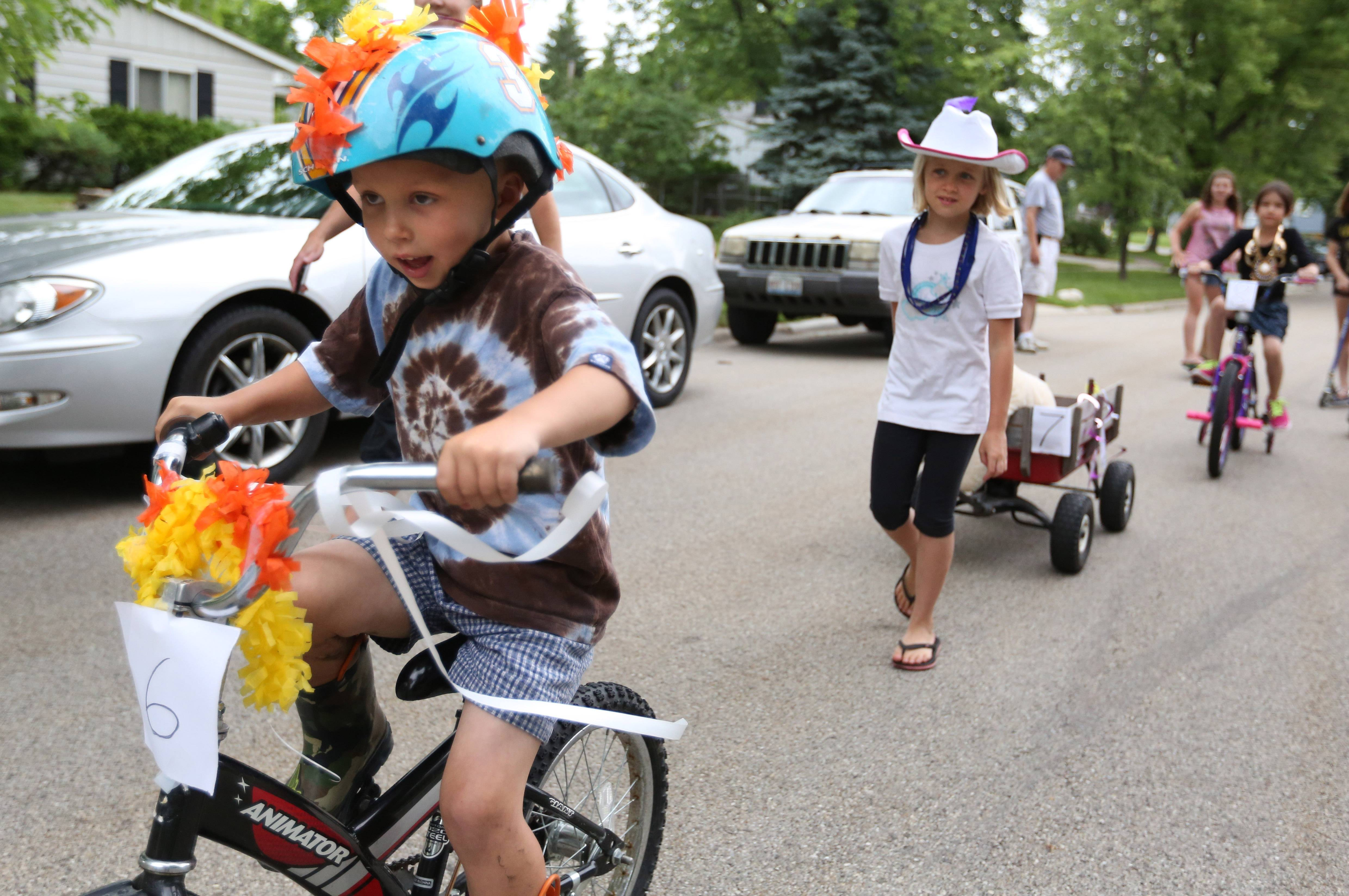 Aaron Jackson, 5, of Grandwood Park rides in a judged kids bike parade near Adams park as part of Grandwood Park Summerfest on Saturday in Grandwood Park near Gurnee.