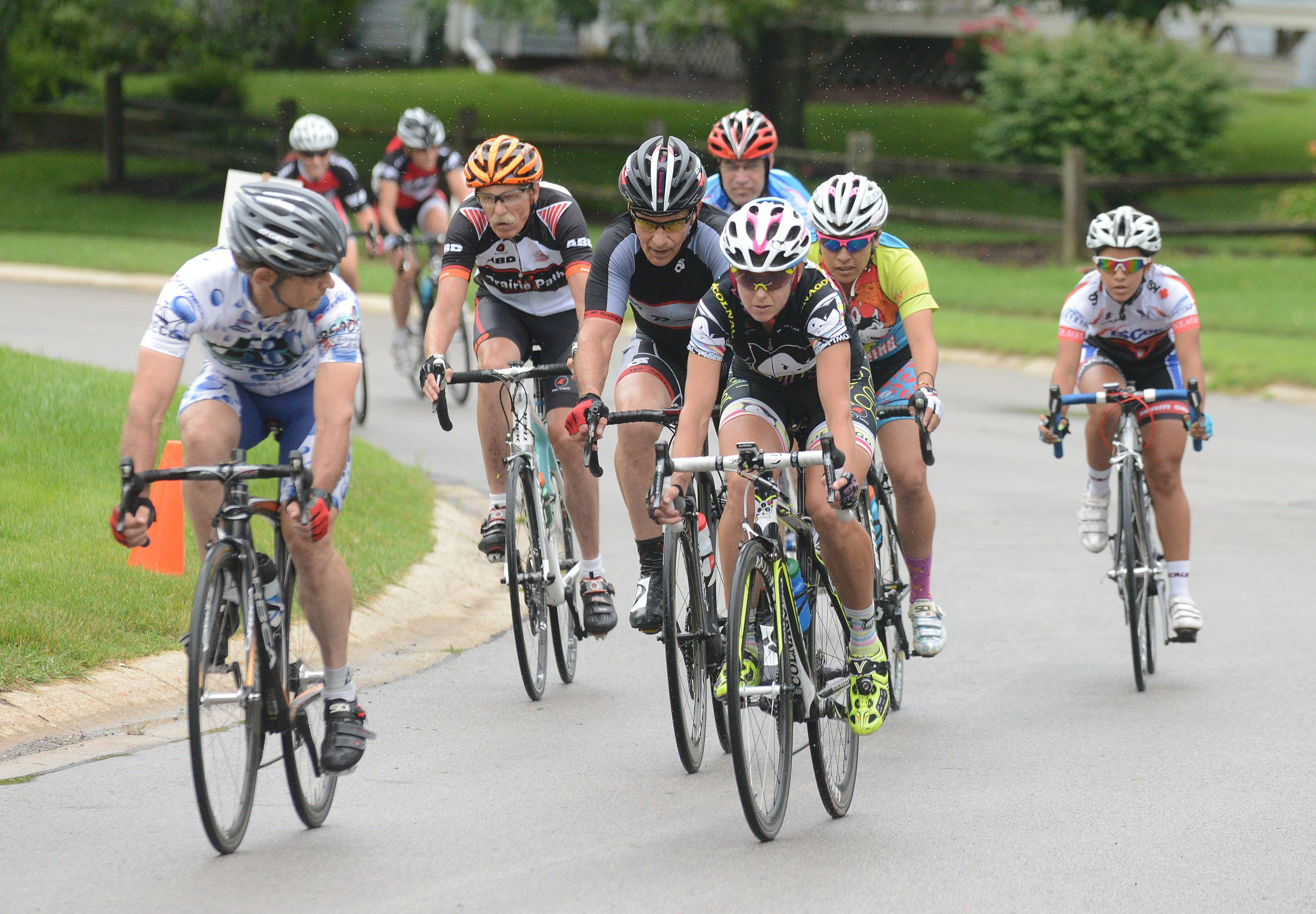 Men and women competitors navigate the 1.2-mile course Saturday during the Winfield Criterium at Oakwood Park.