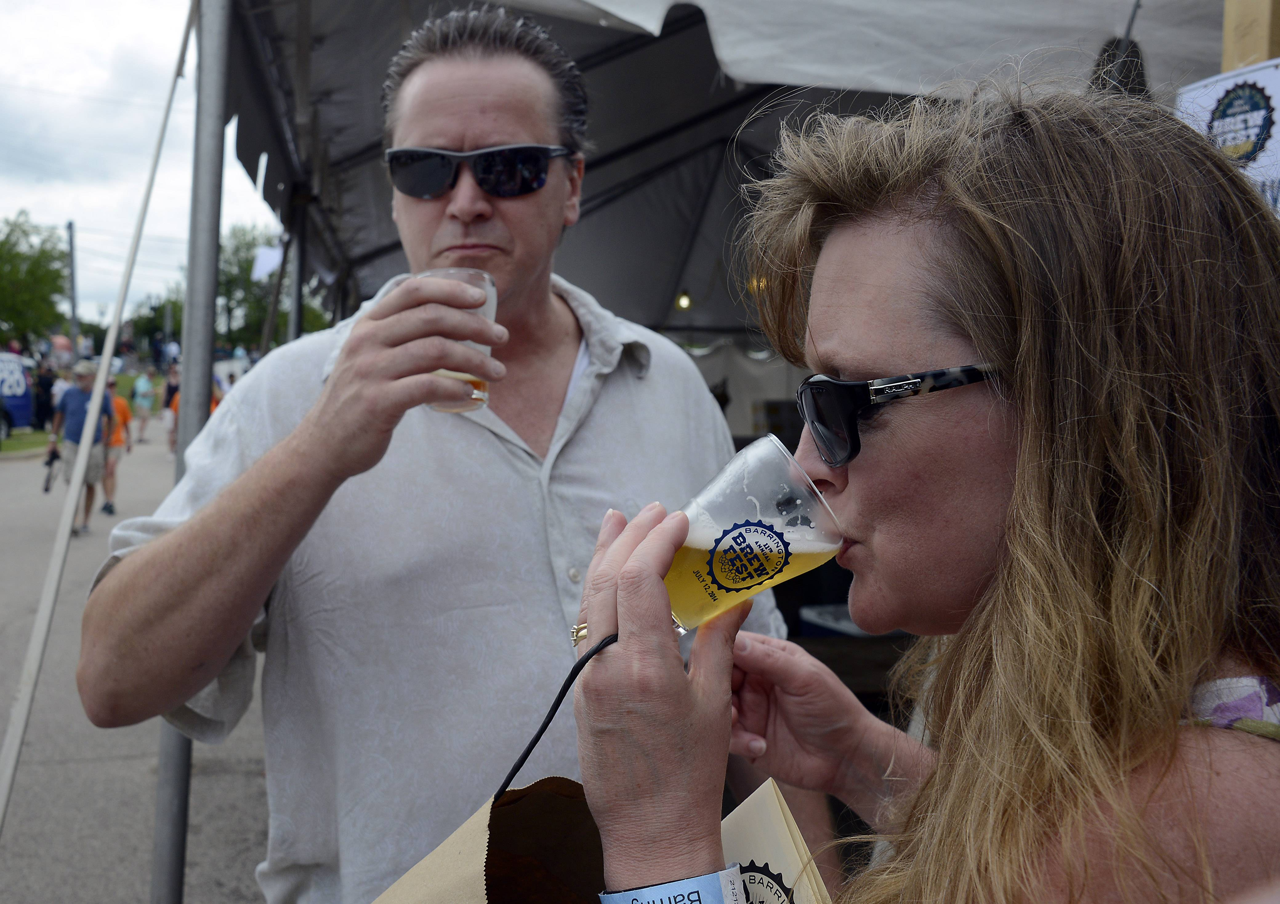 Mark Welsh/mwelsh@dailyherald.comMichael and Mary Utt of Des Plaines sample the Southern Pecan beer from the Lazy Magnolia Brewing Company in Mississippi at the 11th annual Brew Fest in Barrington to open on Saturday.