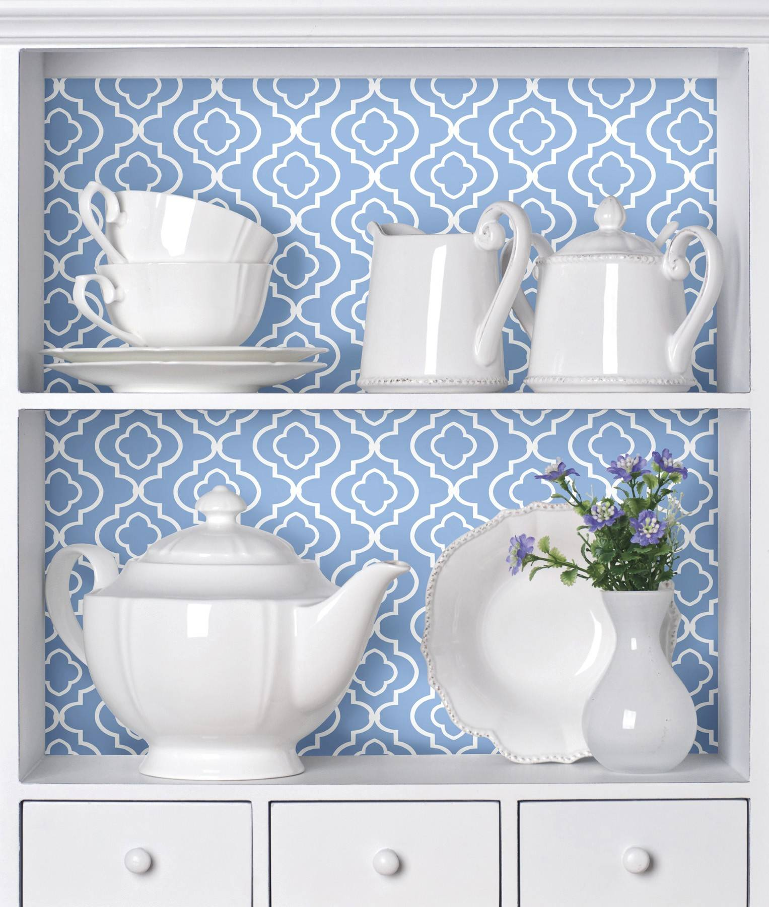 Wallpaper in a display cabinet can serve as a stunning background for basic white dishes.
