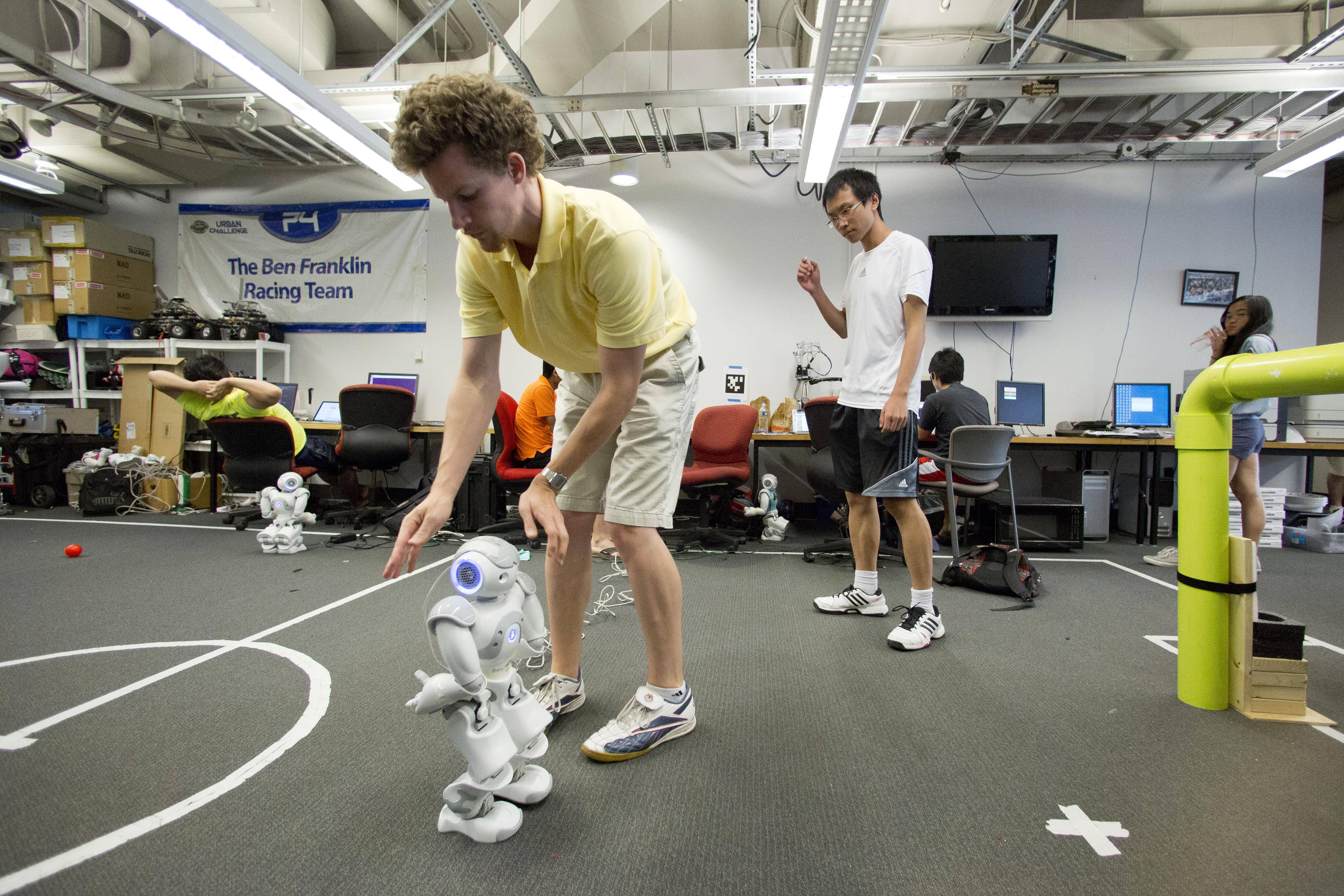 Stephen McGill works with a Nao RoboCup entry. The international robot soccer tournament called RoboCup takes place in Brazil right after the World Cup. The ultimate goal of the yearly event is bold: To create a robot team that can defeat the human World Cup winners by 2050.