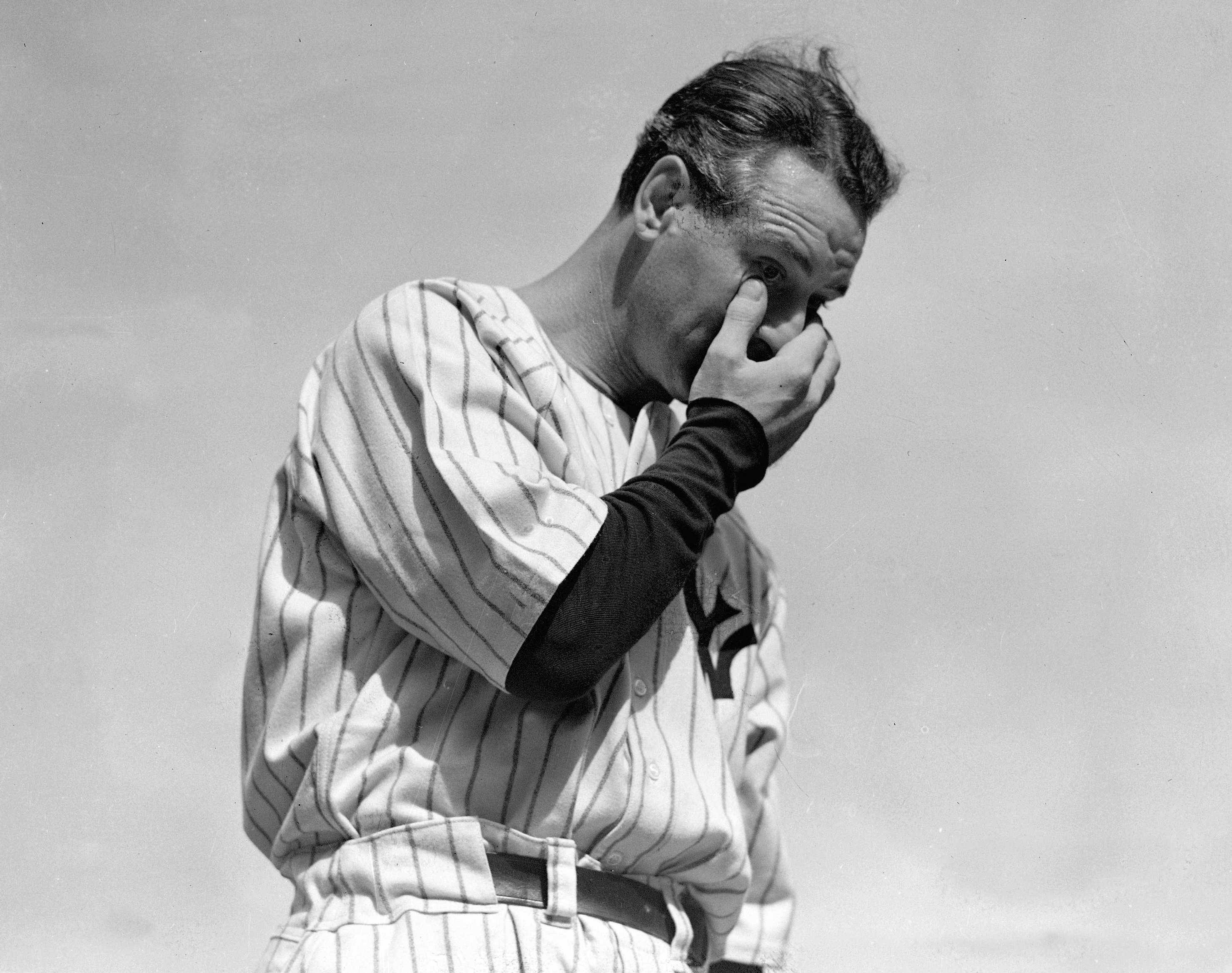 "ASSOCIATED PRESS PHOTOIn this file photo, Yankees' great Lou Gehrig wipes away a tear while delivering his ""Luckiest Man"" speech during a tribute 75 years ago this month at Yankee Stadium in New York."