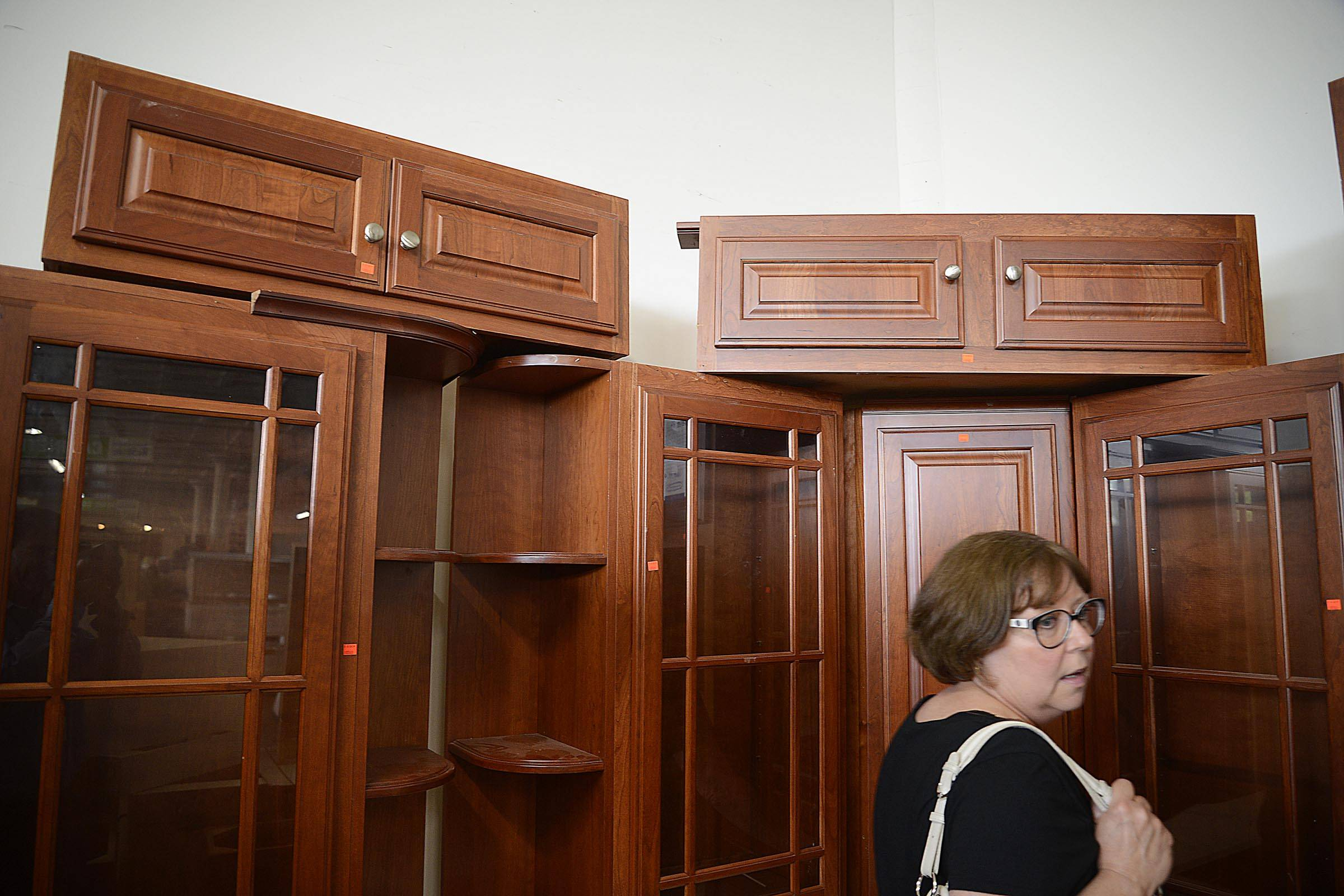 Laurie Parman walks through the cabinet section of the Elgin ReStore. She and husband Greg remodeled their Sleepy Hollow home almost exclusively with items from the business.
