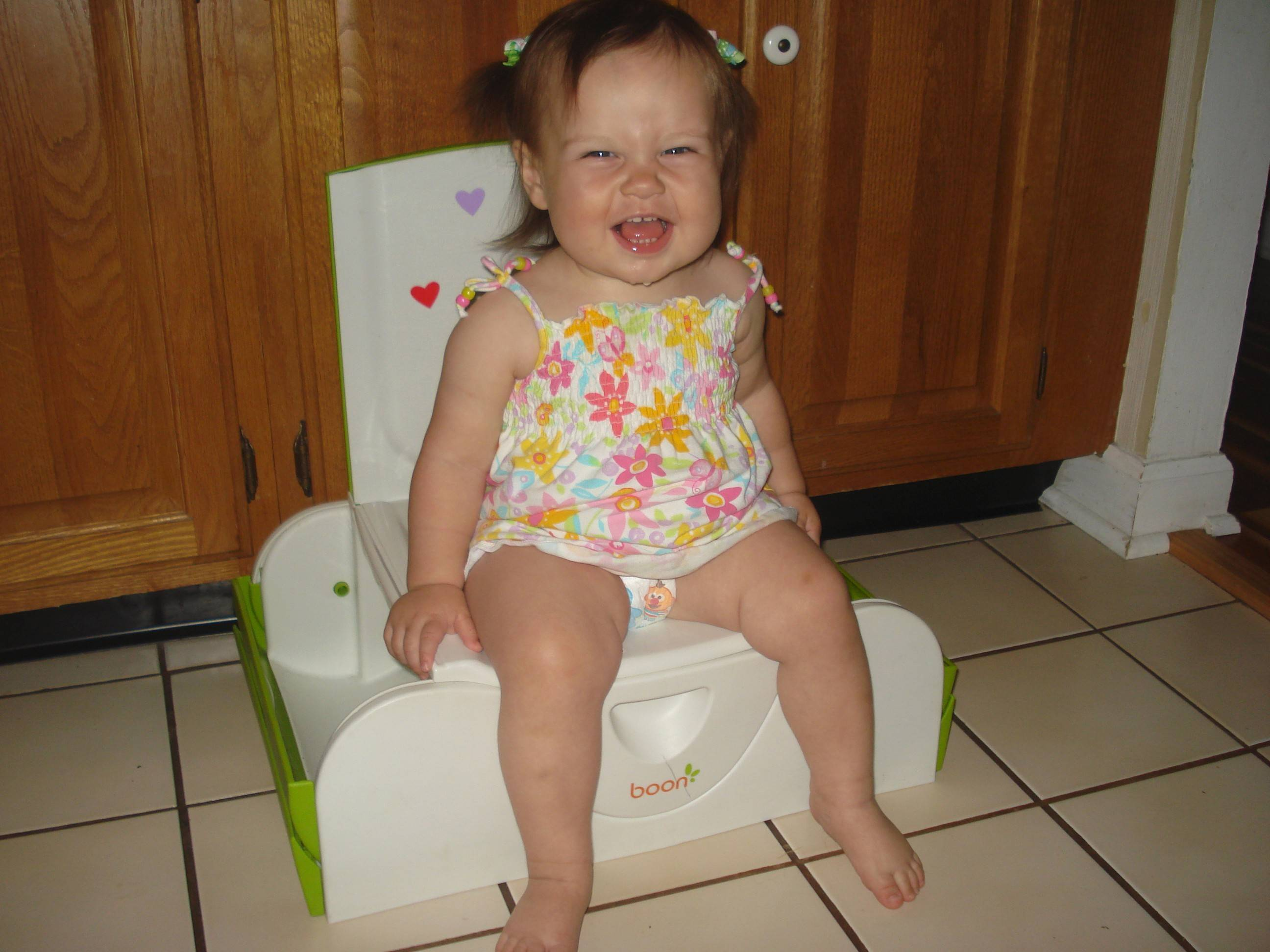 Sophie Slupski, 1, of Schaumburg, tries sitting on a potty for the first time. Anita Chandra-Puri, spokeswoman for the American Academy of Pediatrics said some children start showing an interest in the potty at around 18 months, but typically aren't ready to train until 2½. Sophie is the author's daughter.