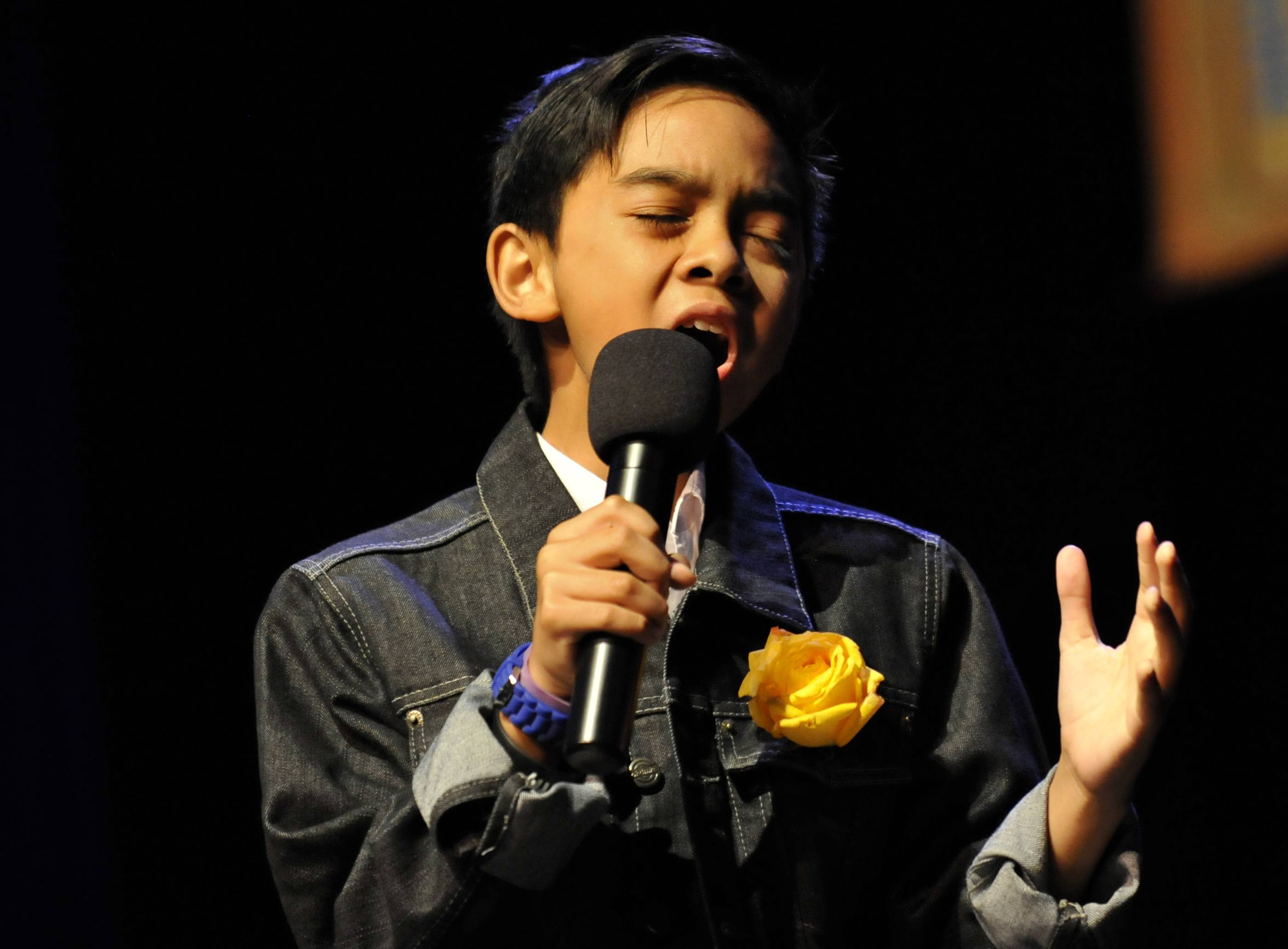 James Agena performs at the Suburban Chicago's Got Talent top 15 competition at Prairie Center for the Arts in Schaumburg on Sunday.