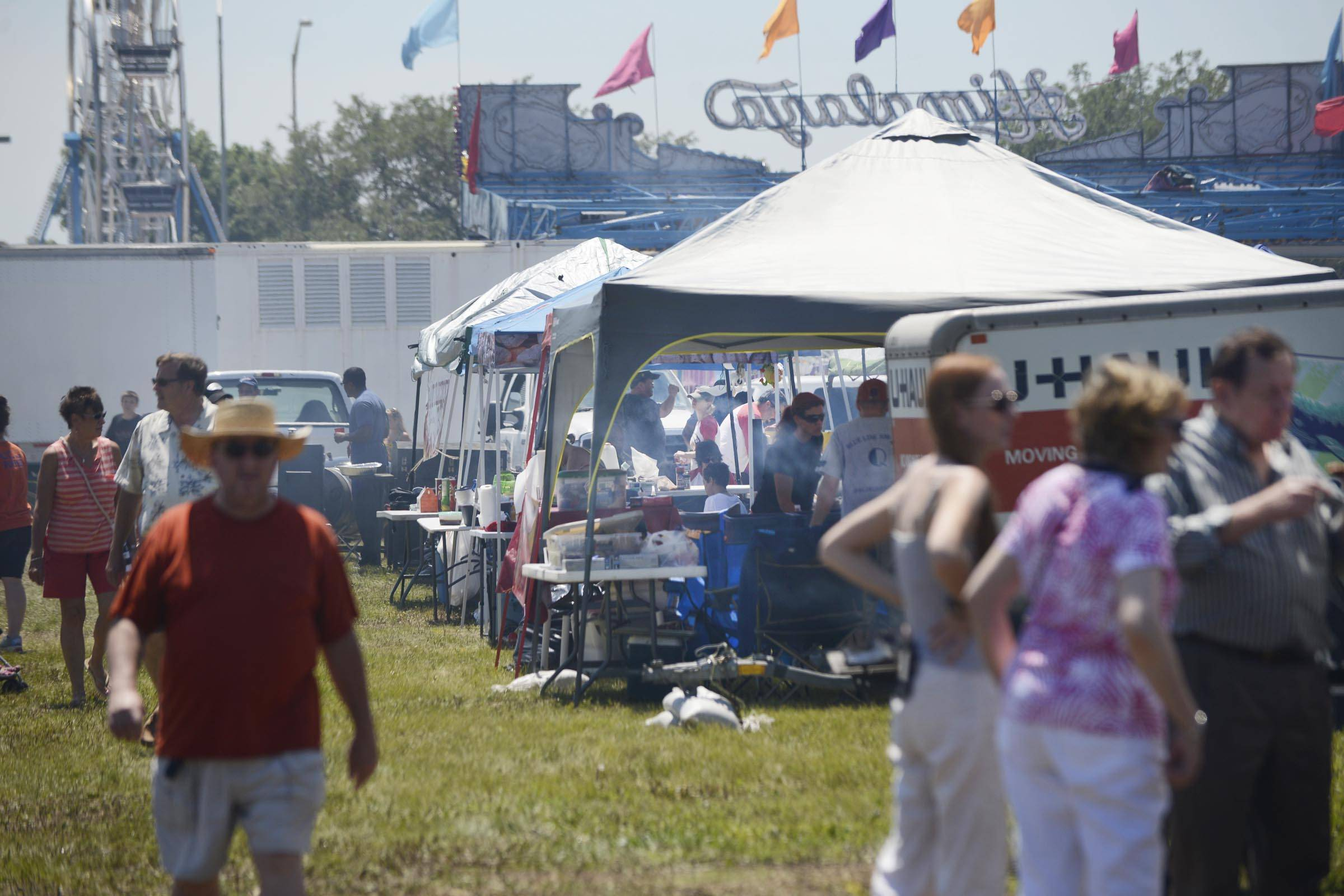 BBQ fans wander the Firin' Up The Fox BBQ Competition and Festival in St. Charles on Sunday.