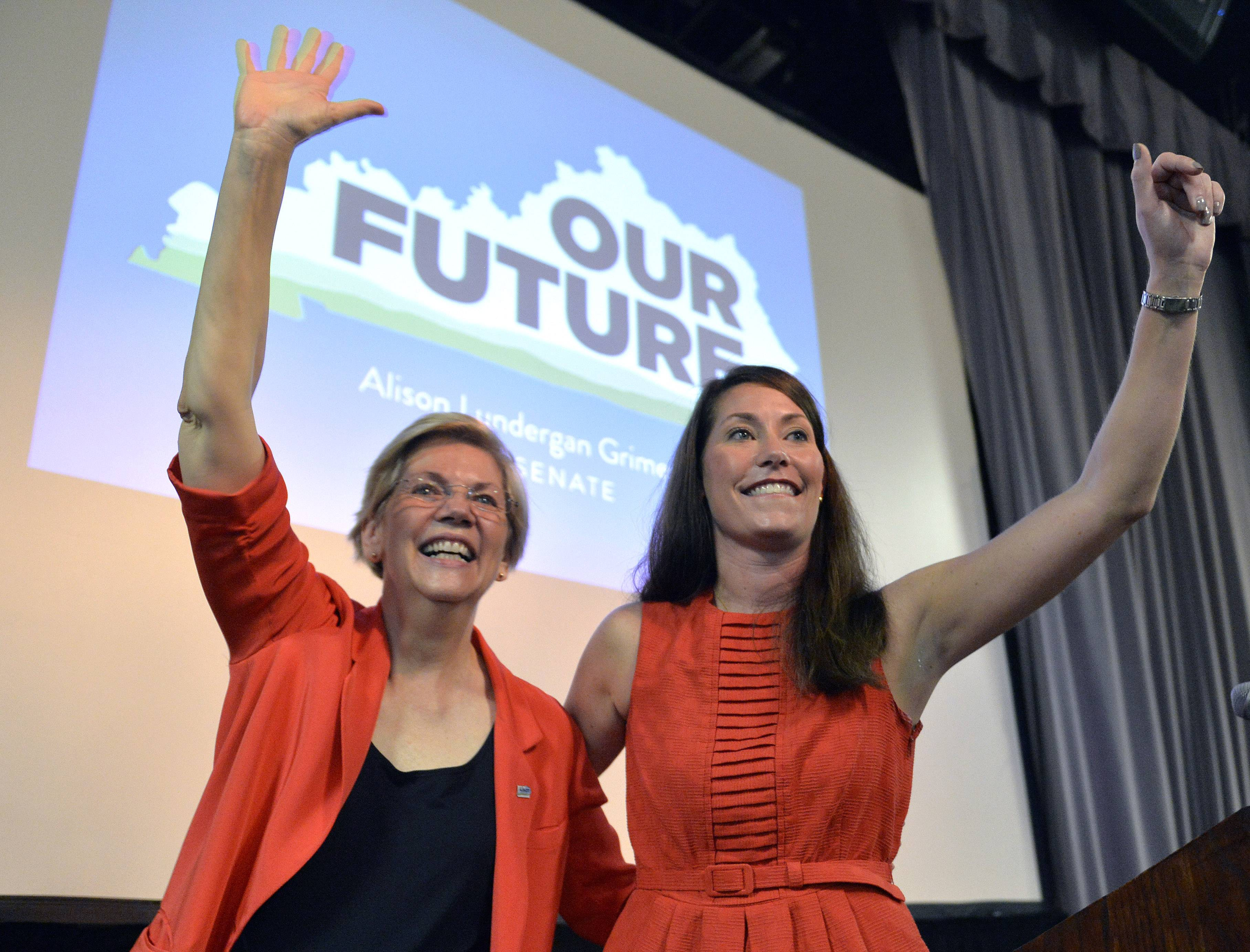 Sen. Elizabeth Warren, left, and Kentucky Democratic Senatorial candidate Alison Lundergan Grimes wave to supporters at at rally in Louisville, Ky., June 29. Warren is quickly becoming a top Democrat fund-raising and campaigning powerhouse.