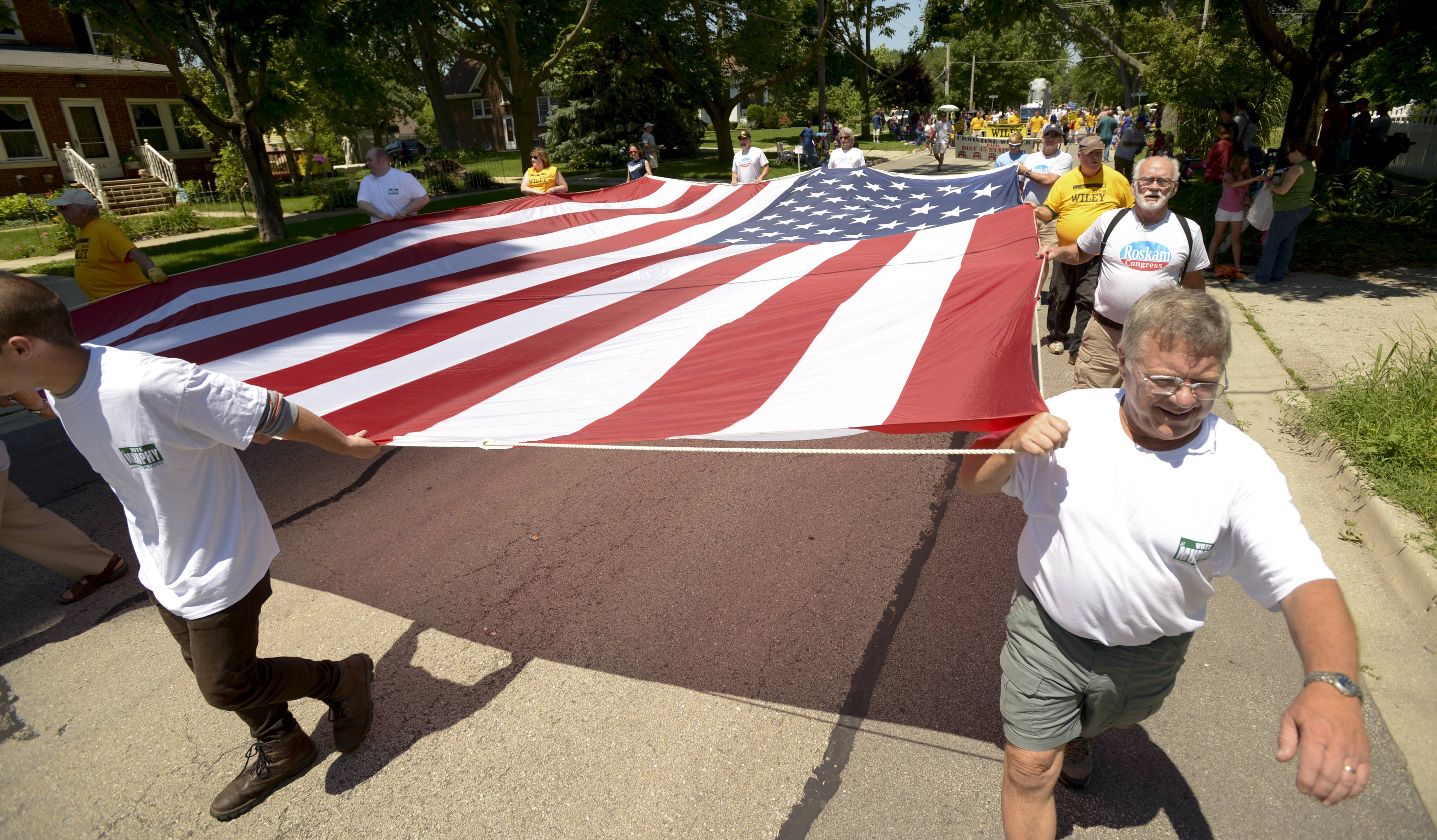 A huge American flag is carried Sunday in the West Chicago Railroad Days Parade by supporters of area Republican candidates.