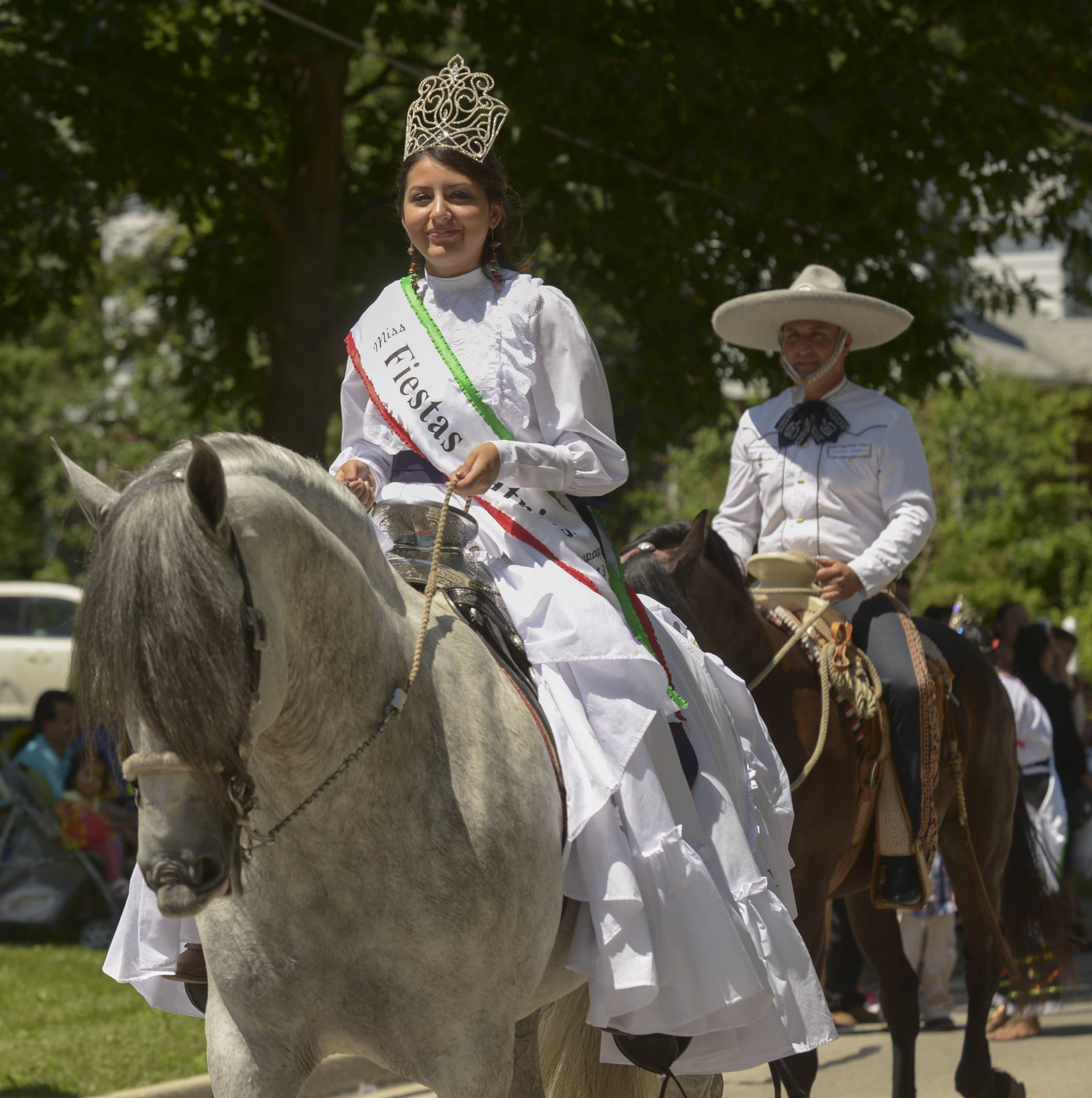Angelica Gallegos, Miss Fiesta Patrias 2013, rode a horse Sunday in West Chicago's annual Railroad Days Parade.