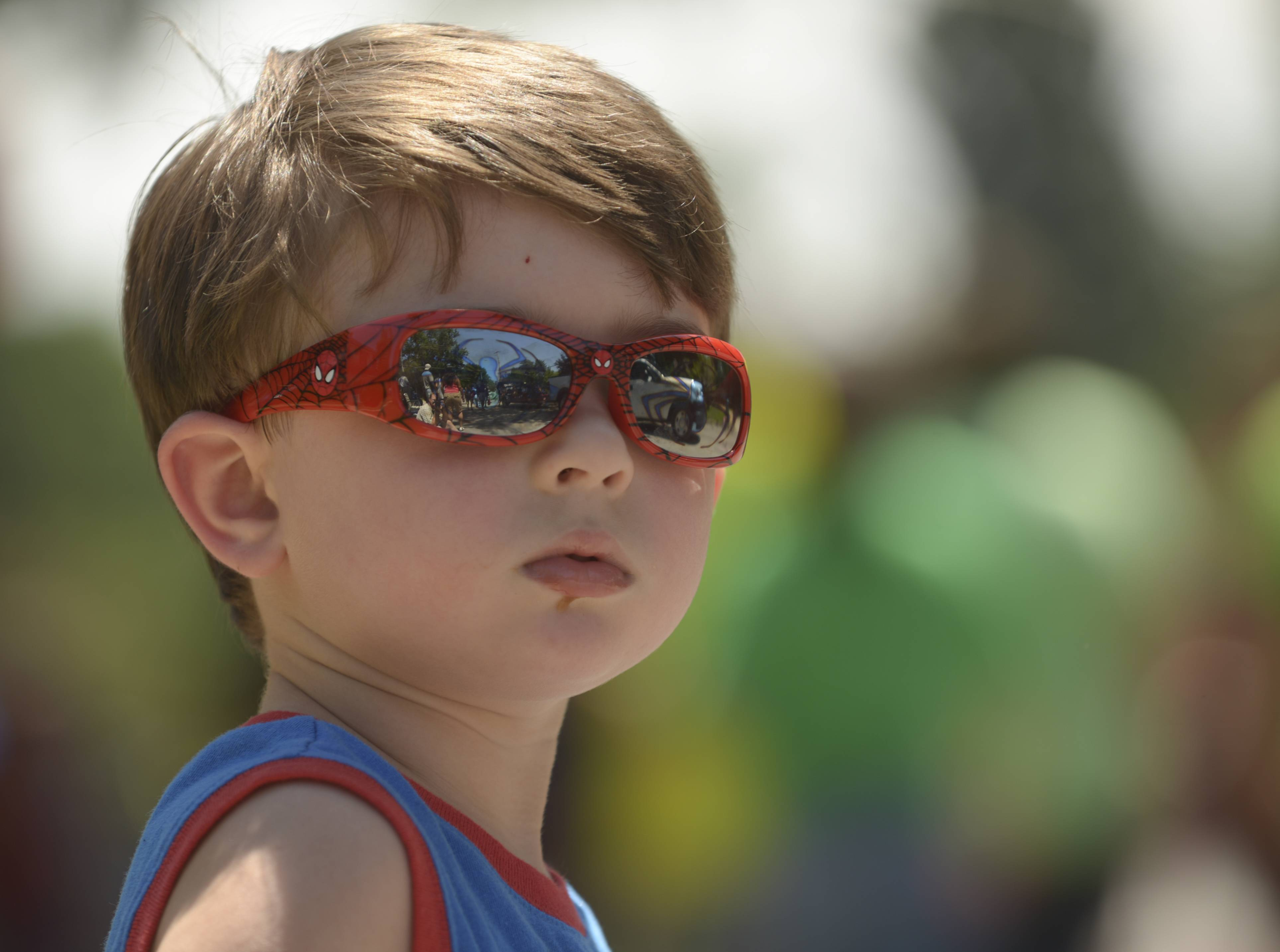 Angelo O'Neill, 3, of West Chicago keeps a keen eye out for candy Sunday as the annual Railroad Days Parade passes by in West Chicago.