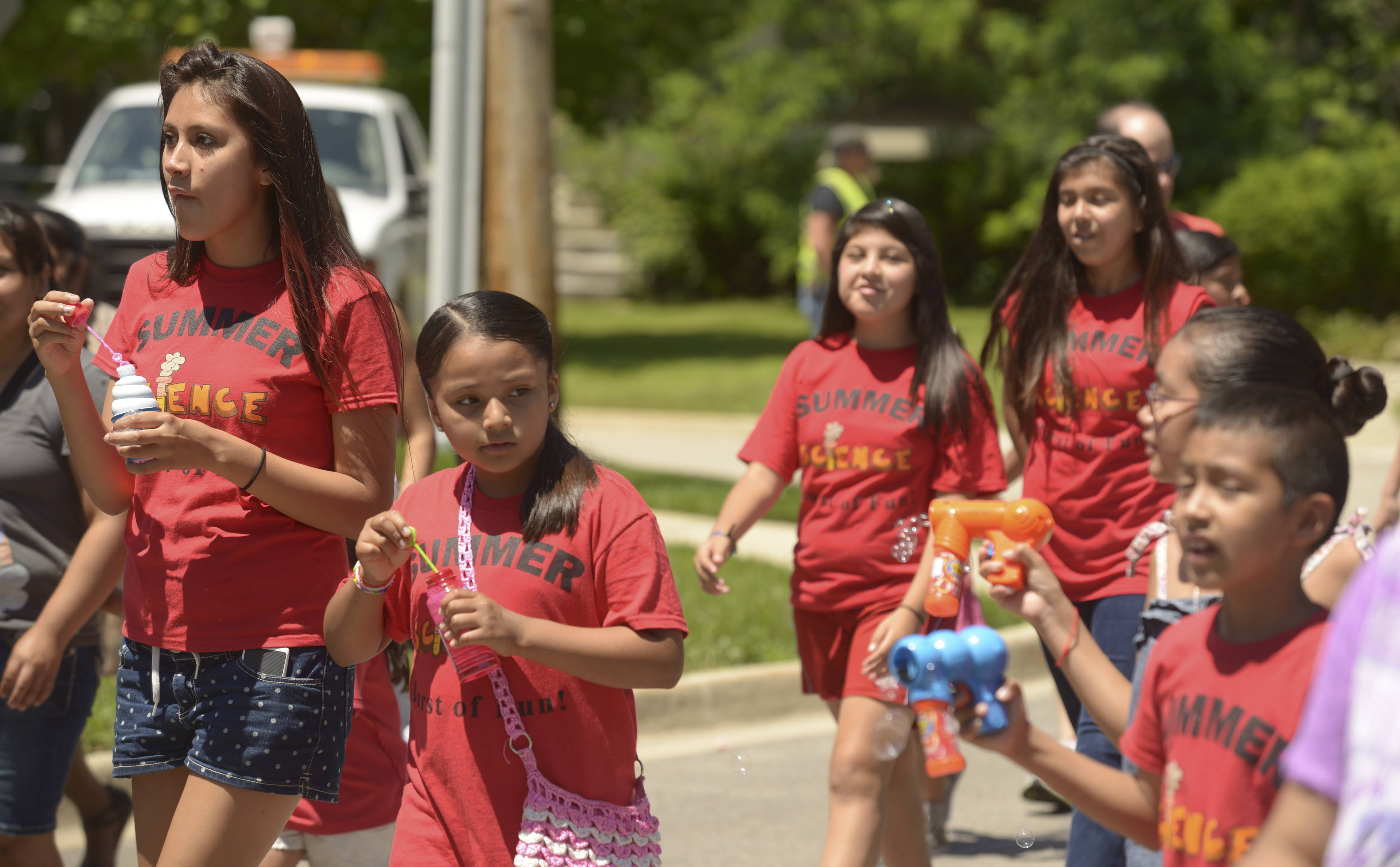 Students in the West Chicago Elementary School District 33 summer science camp march Sunday in the annual Railroad Days Parade.