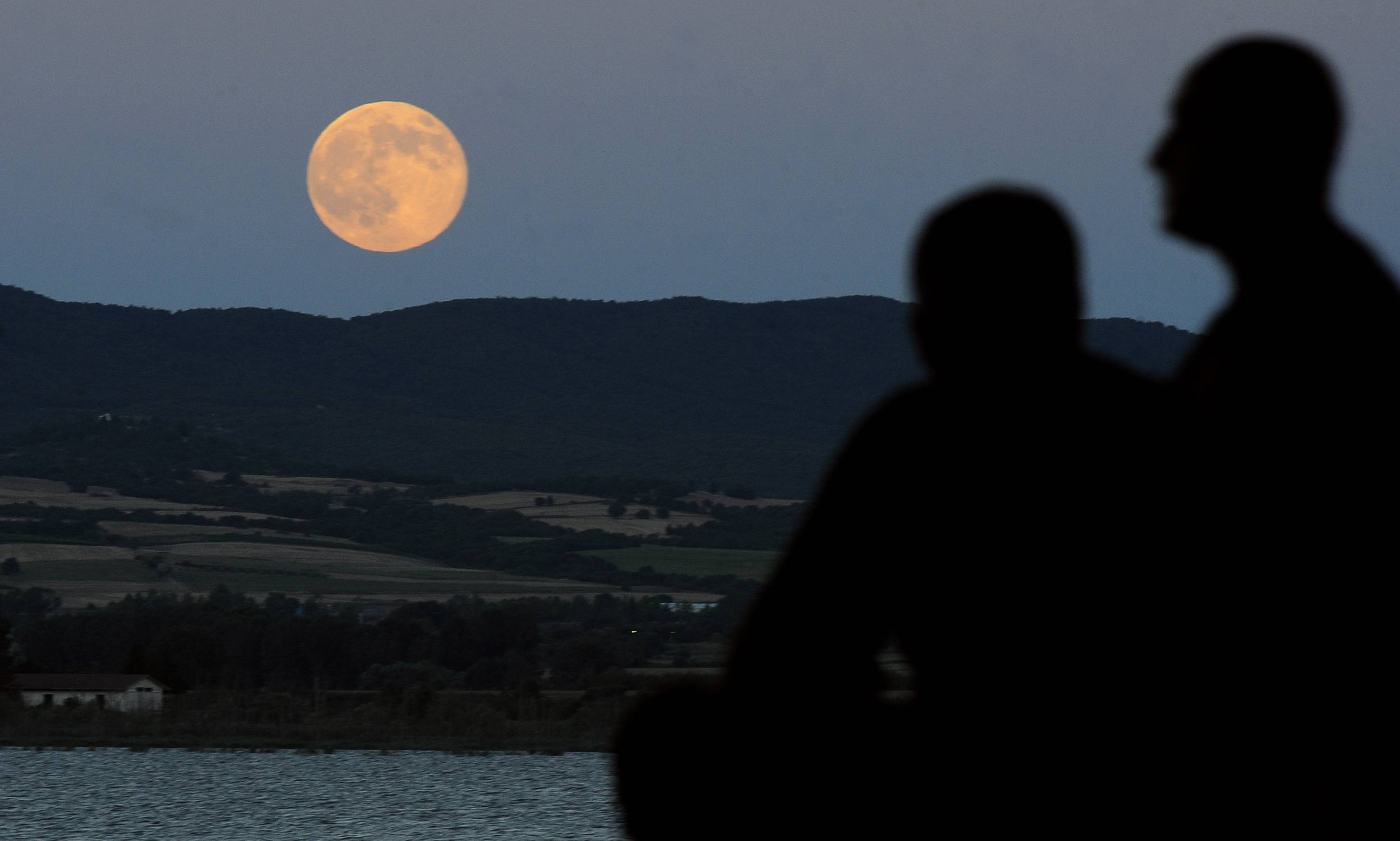 "A perigee moon also known as a supermoon rises above Dojran Lake in southeastern Macedonia, Saturday, July 12, 2014. The phenomenon, which scientists call a ""perigee moon,"" occurs when the moon in its elliptical orbit is relatively close to Earth and seen from the Earth near the horizon, appears larger and brighter than other full moons."