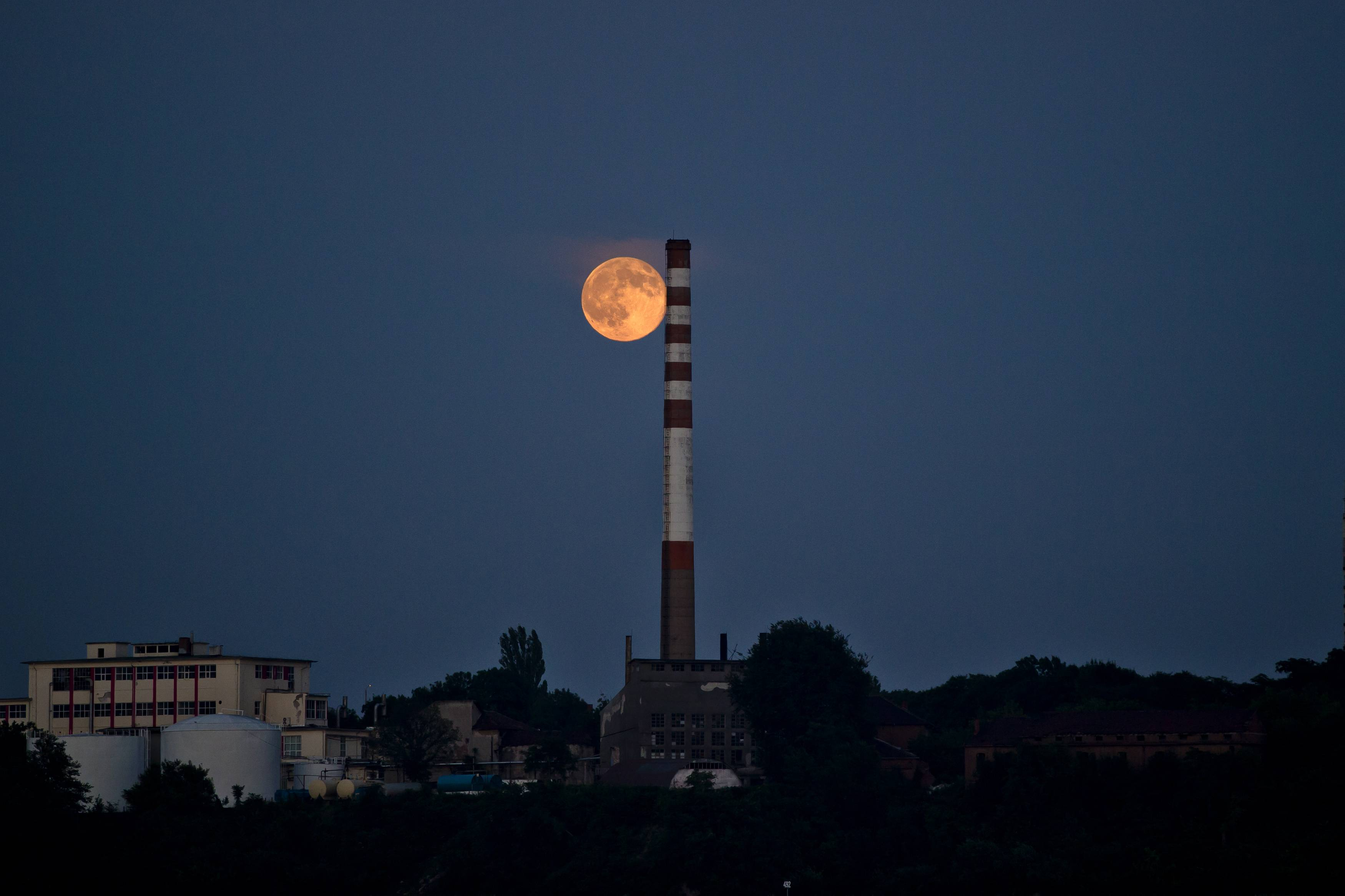 "A perigee moon, known as a supermoon appears above the Bulgarian-Romanian border in Giurgiu, Romania, Saturday, July 12, 2014. The phenomenon, which scientists call a ""perigee moon,"" occurs when the moon is near the horizon and appears larger and brighter than other full moons."