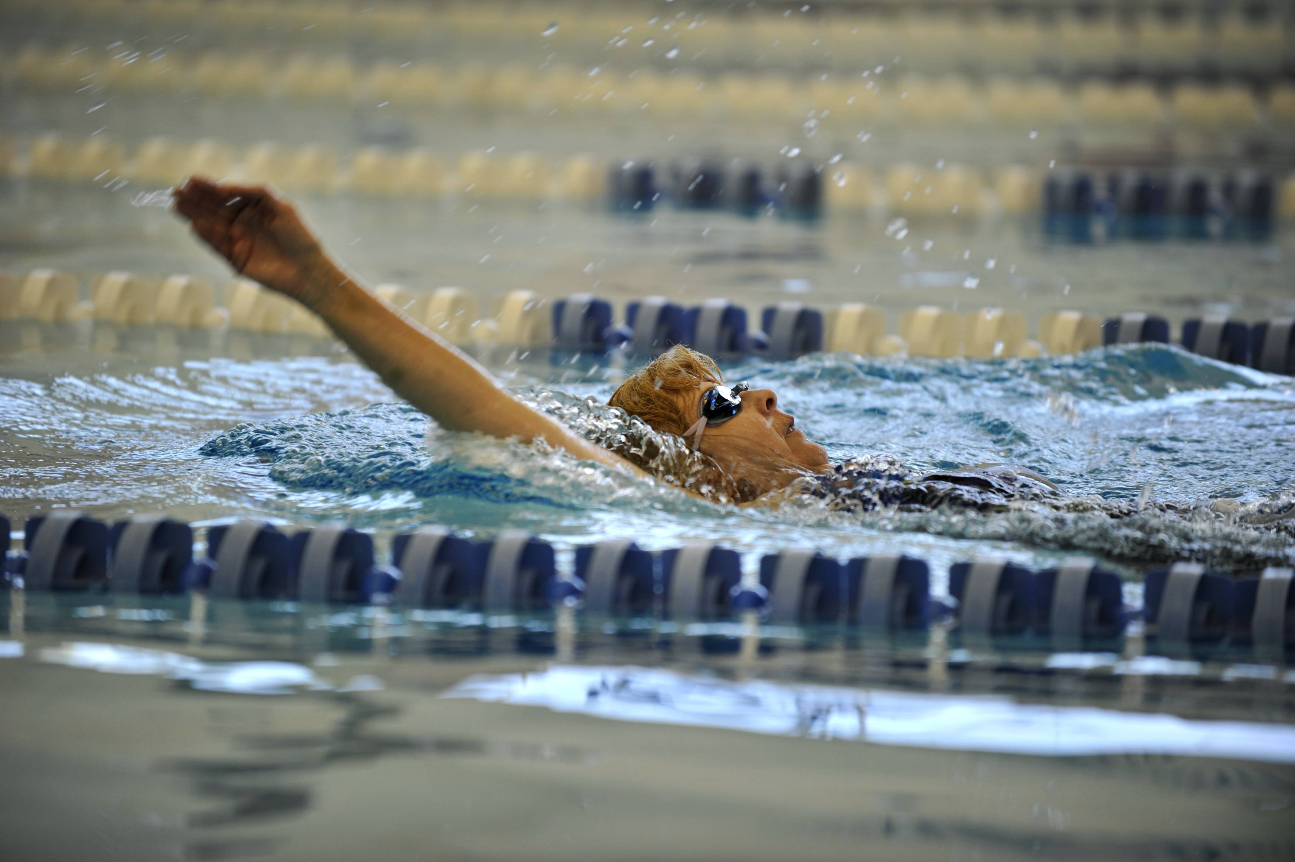 Practicing a smooth backstroke at the Vaughn Athletic Center pool in Aurora, heart-transplant recipient Donna Stout of Batavia competes today in the Transplant Games of America in Houston.