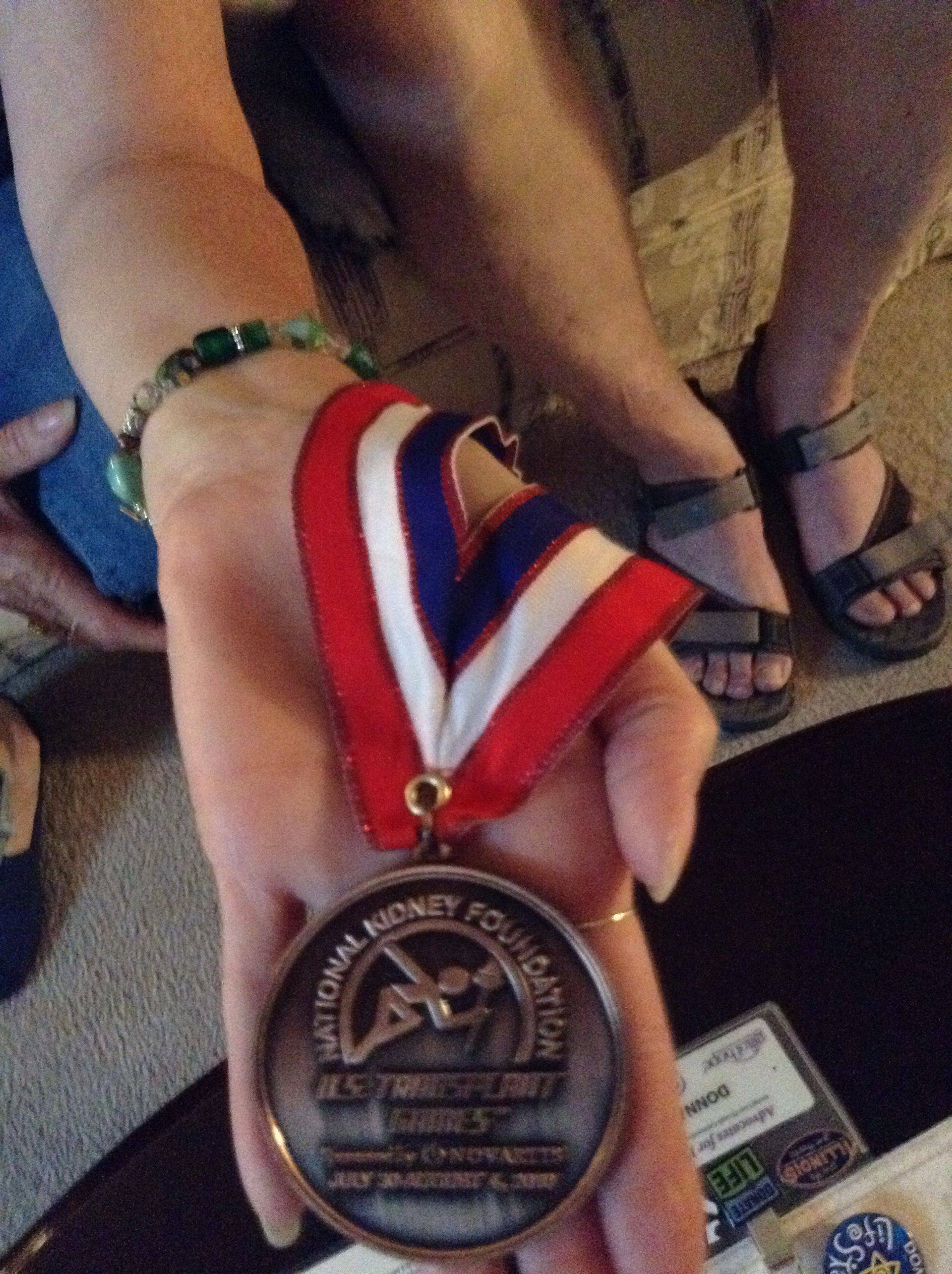 Having finished just 0.4 seconds off the medal stand in a previous Transplant Games of America, Donna Stout was given this bronze medal by the woman who beat her out for third place. A heart-transplant recipient, Stout says she'll give the medal to her donor's family if they want to meet her.