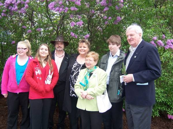 While they wish they could have met in a different way, Colette Jordan, center, got to thank the family of her donor, Tom Kaiserauer, during this 2011 tree-planting ceremony in Naperville to promote organ donation. Kaiserauer's parents, Otto, right, and Annette Kaiserauer, to the right of Jordan, introduced grandchildren Andrew, second from right, and Katie, far left, to Jordan's husband, John, in hat, and daughter Nikki, second from left,