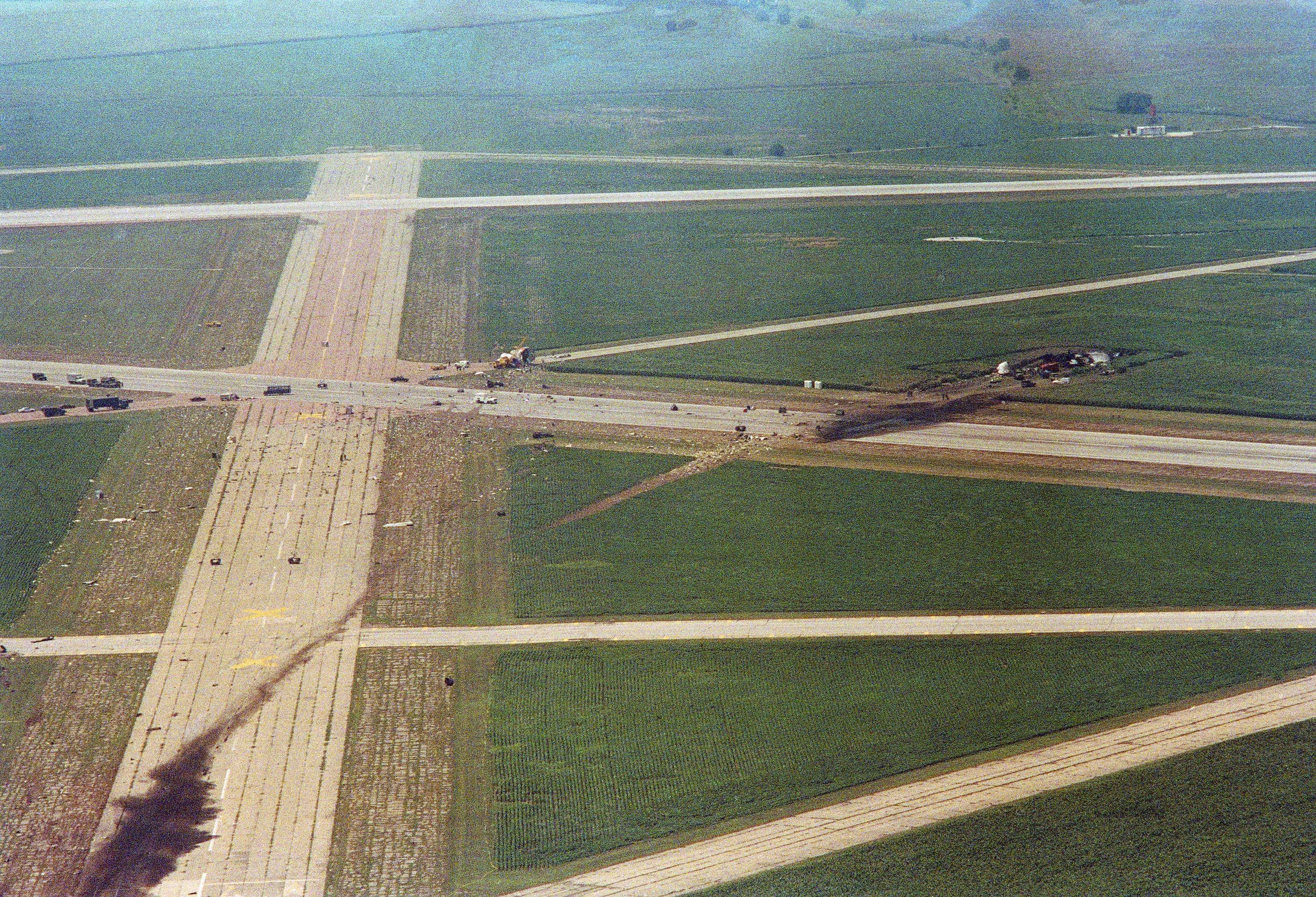 A burnt area shows the contact point and crash path of United Airlines flight 232 after it exploded on impact during an attempted emergency landing at Sioux City Airport in Sioux City, Iowa on July 20, 1989. The old runways of the original airport, now used as taxiways, are seen criss-crossing the crash path. The pilot was attempting to land on one of the closed runways.