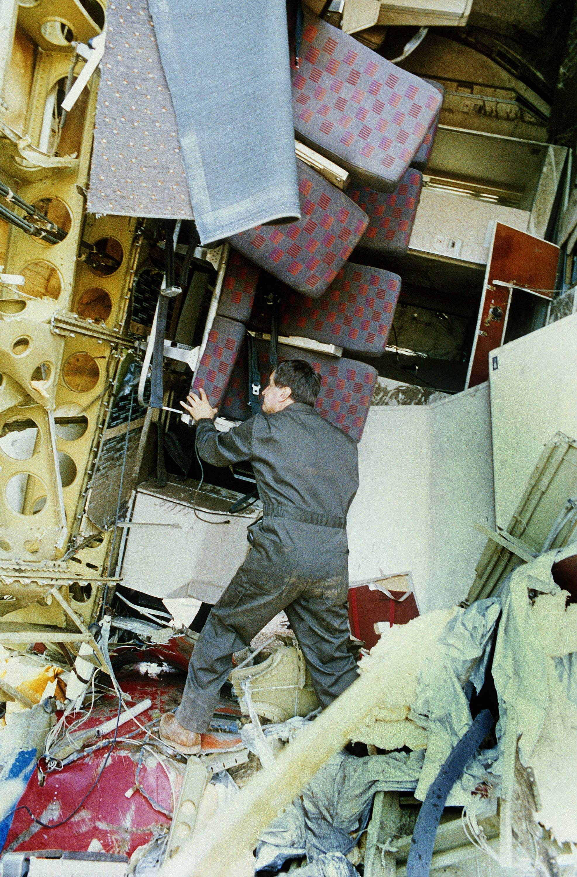 A National Transportation Saftey Investigator looks at the ruptured passenger compartment of the United Airlines DC-10 in Sioux City, Iowa, Friday, July 21, 1989.