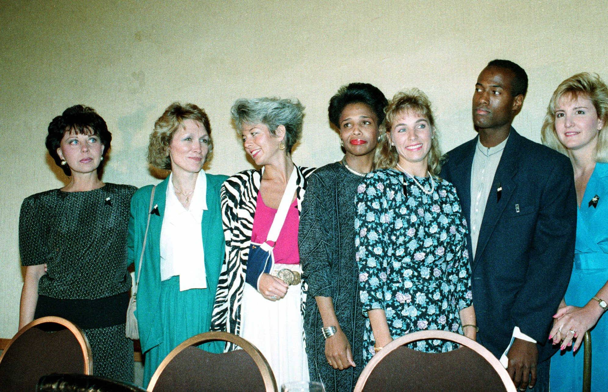 Flight attendants who aided the victims of United Flight 232 crash in in Sioux City, Iowa, pose July 28,1989 at a news conference in Chicago. From left, are: Georgeanne Del Castillo, Janice Brown, Virginia Murray, Donna McGrady, Susan White, and Timothy Owens.  Woman at right is unidentified.