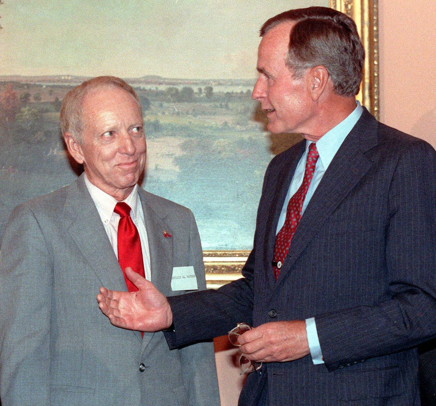 President George Bush, right, meets with Capt. Alfred Haynes at the White House in this Sept 7, 1989 photo. Haynes guided the disabled United Airlines flight 232 aircraft in Sioux City, Iowa.   He and co-pilots Dudley Dvorak, Bill Records and Dennis Fitch, crushed in the rubble, hung upside down for 40 minutes before rescue crews discovered them.