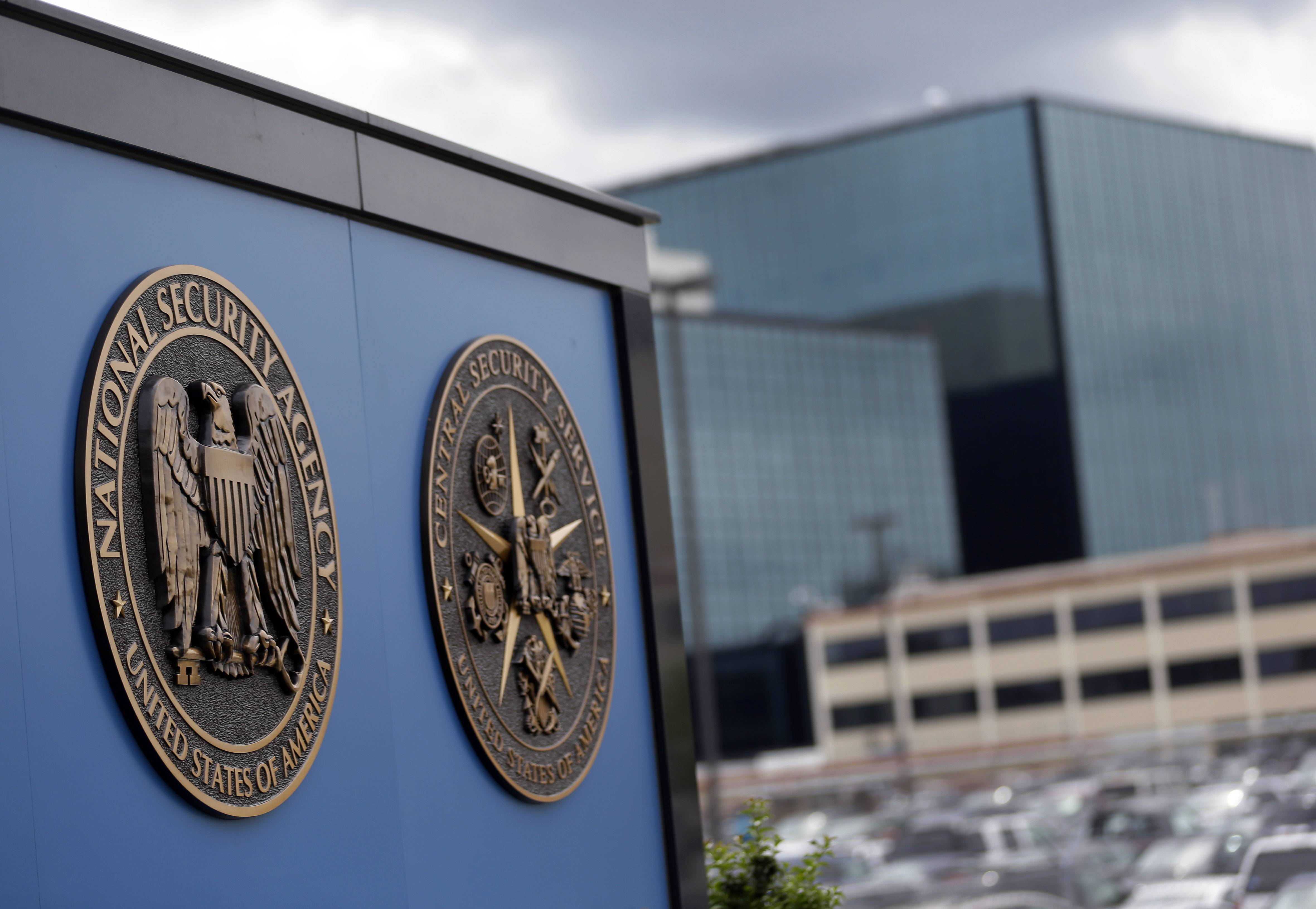 In this June 6, 2013, file photo, shows plaques outside the National Security Agency (NSA) campus in Fort Meade, Md. When the NSA intercepted the online accounts of legally targeted foreigners over a four-year period it also collected the conversations of nine times as many ordinary Internet users, both Americans and non-Americans, according to an investigation by The Washington Post.