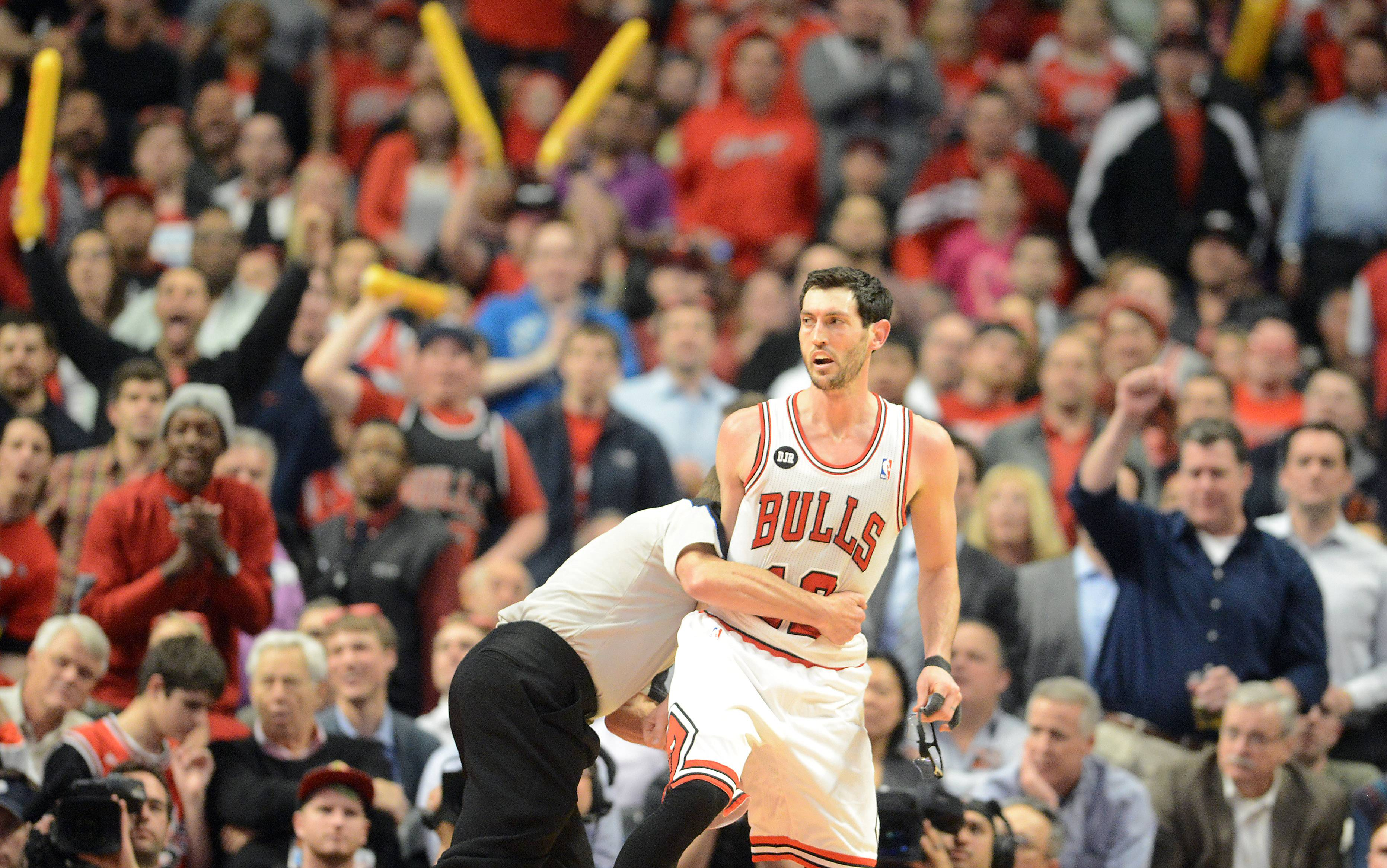 Bulls guard Kirk Hinrich (12) is pulled back by official Bill Spooner after he got into it with Washington Wizards guard Bradley Beal (3) during Tuesday's game at the United Center in Chicago.