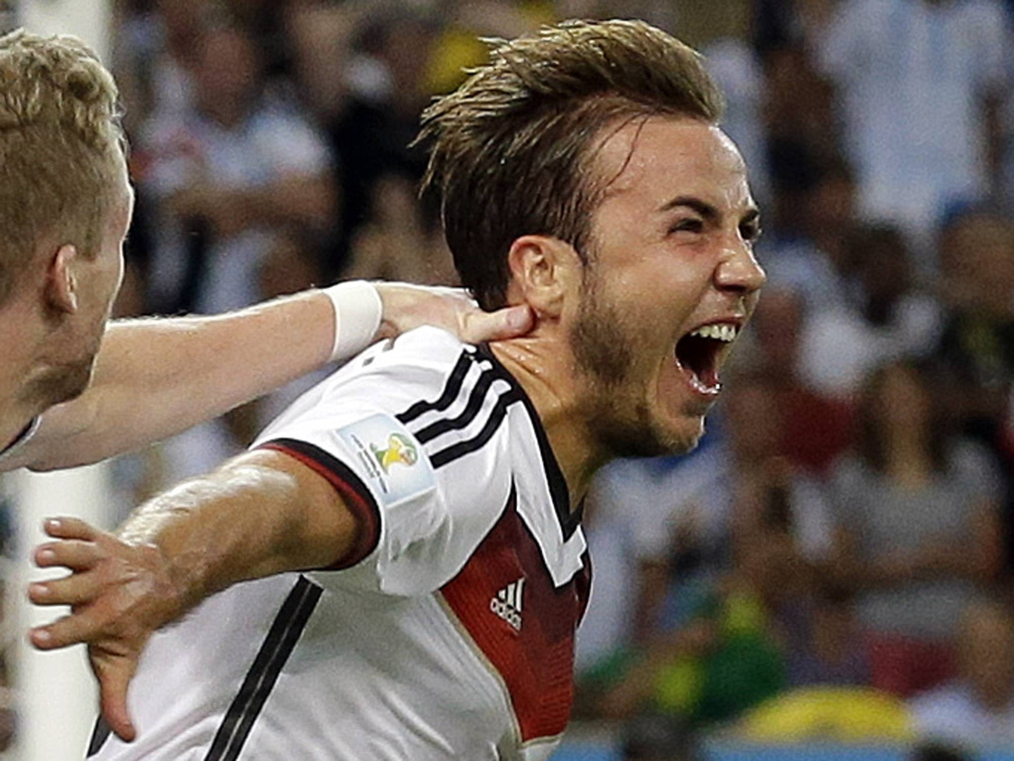Germany's Mario Goetze celebrates after scoring the opening goal during the World Cup final soccer match between Germany and Argentina at the Maracana Stadium in Rio de Janeiro, Brazil, Sunday, July 13, 2014.