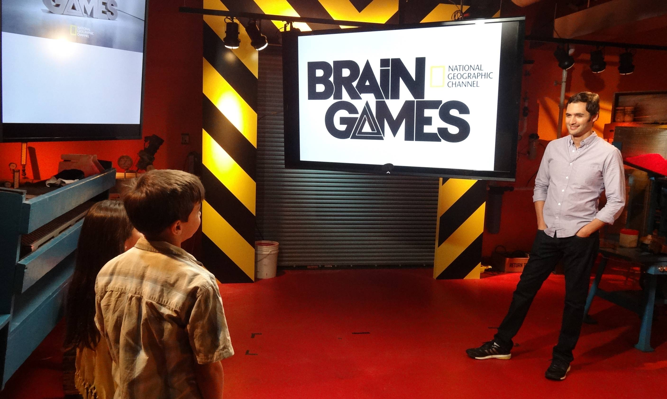 "Jason Silva, right, guides viewers through experiments designed to show how the brain perceives things like motion, space or time on ""Brain Games"" on the National Geographic Channel."