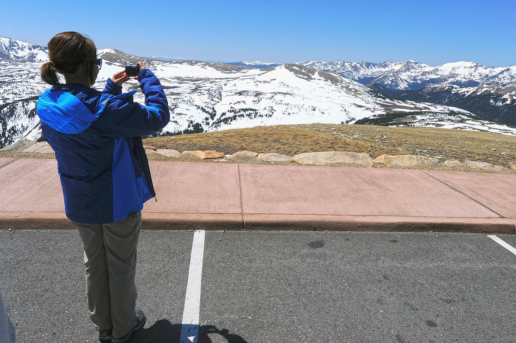 ASSOCIATED PRESS Brazilian national Maria Mackmillan snaps a photo from Gore Overlook on Trail Ridge Road in Rocky Mountain National Park outside Estes Park, Colo. Two fatal lightning strikes on consecutive days in July 2014 pinpoint dangers not always apparent to visitors to the 11,000-foot exposed high country of Rocky Mountain National Park. Afternoon storms visible miles away arrive overhead suddenly.