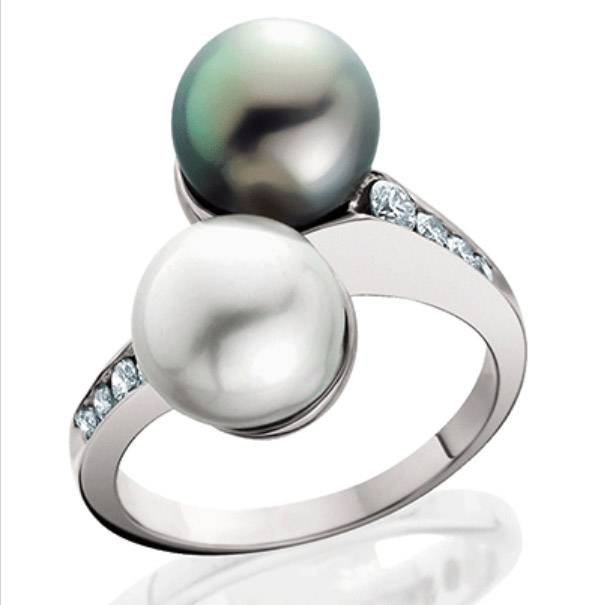 Gems from the ocean include pearls and sometimes diamonds. This white gold ring sparkles with diamonds, a Tahitian black pearl and a white cultured pearl, designed by Sam Chau, accredited jewelry professional.