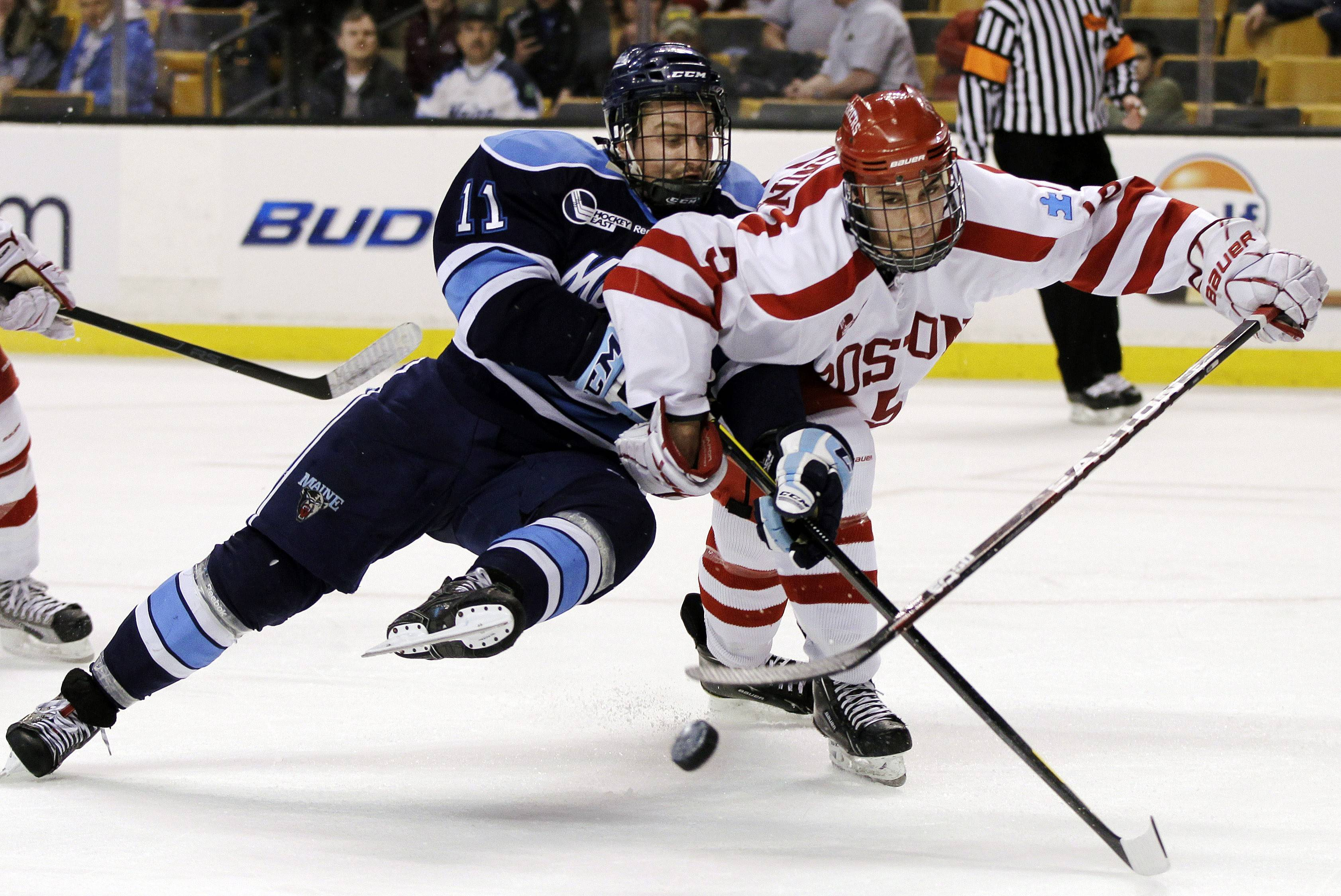 Adam Clendening (5) shown here playing for Boston University in 2012, has put in his time at Rockford, last season setting an IceHogs' franchise record for assists by a defenseman (47), ranking second among all AHL defensemen with 59 points and being named to the 2013-14 AHL first all-star team. He is hoping to see action with the Hawks this season.