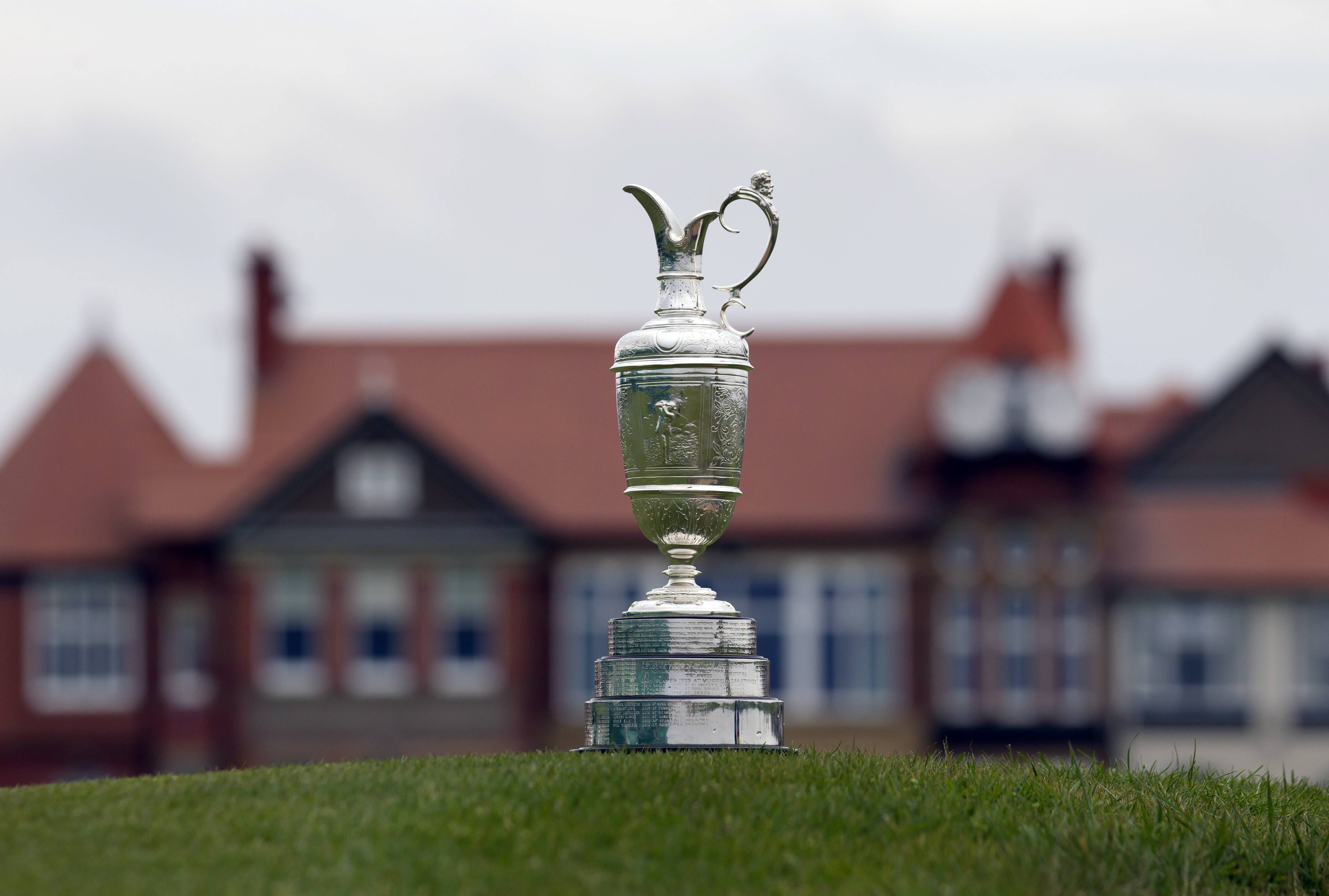 "The British Open Golf trophy the ""Claret Jug"" is displayed by the clubhouse at the Royal Liverpool Golf Club in Hoylake, England. The British Open golf championship begins on Thursday."