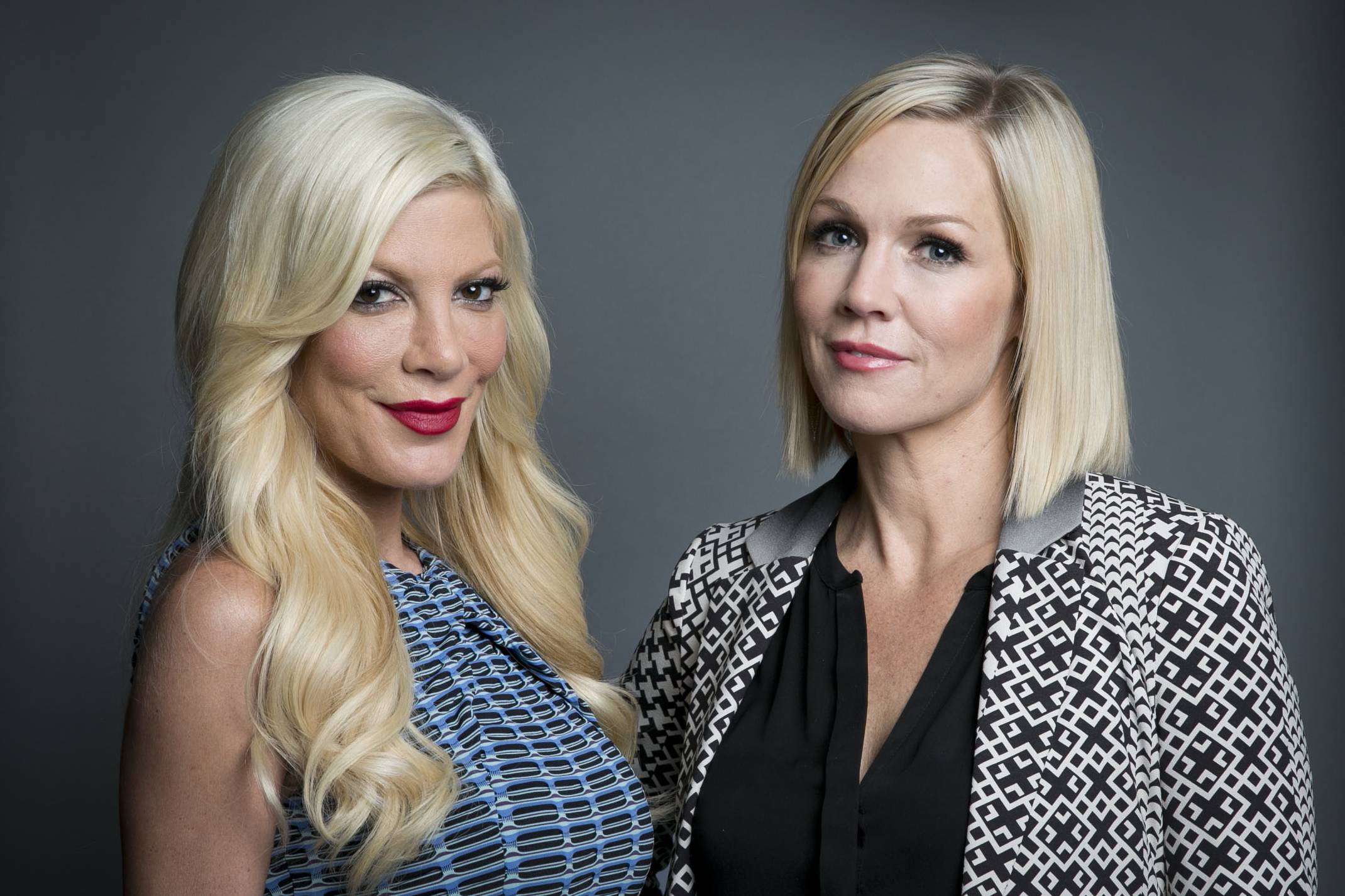 "Original co-stars of the Fox television series ""Beverly Hills, 90210"" actresses Tori Spelling, left, and Jennie Garth are glad they've reunited for the ABC Family series ""Mystery Girls,"" which airs on Wednesdays."