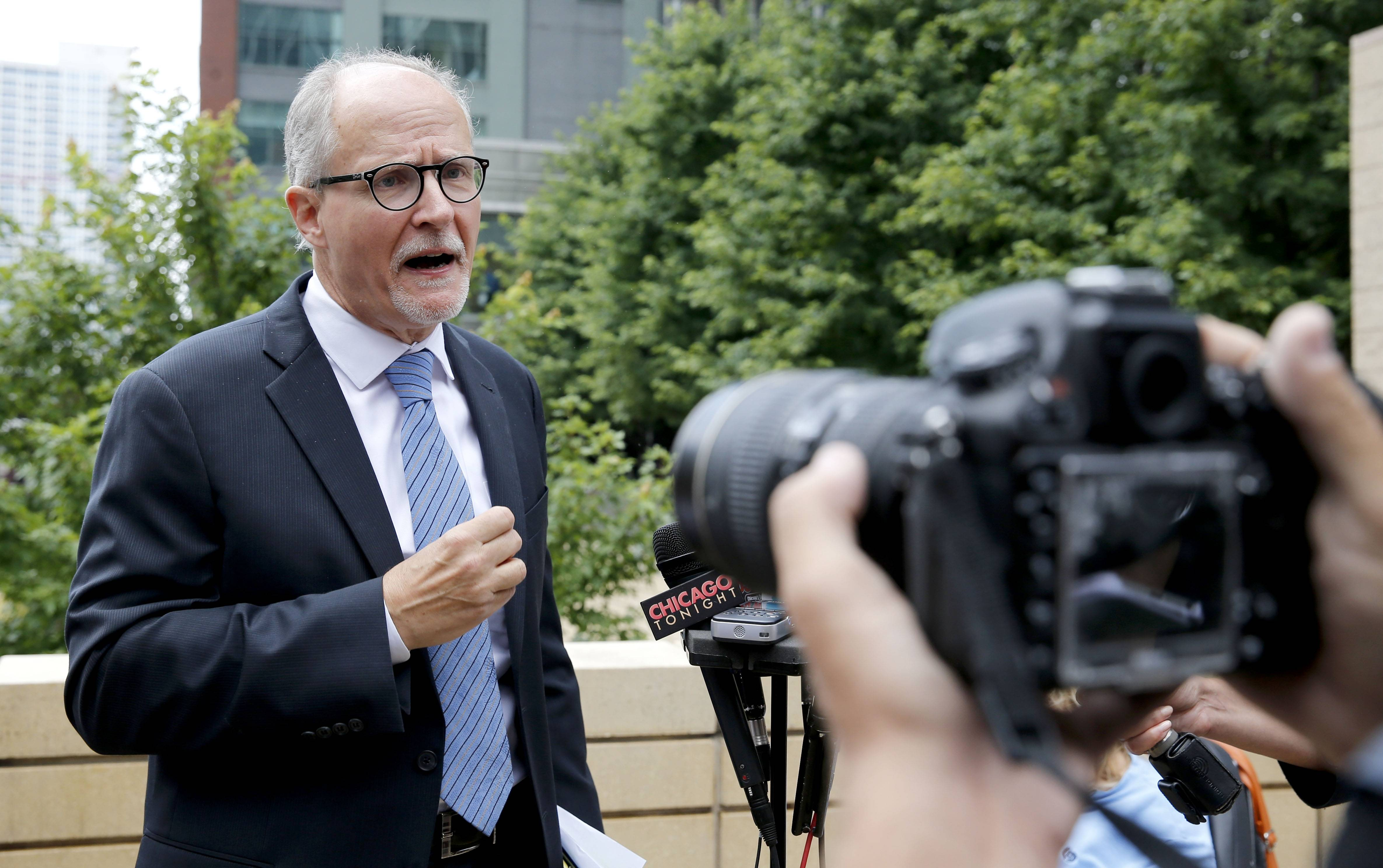 Democratic Lt. Gov. candidate Paul Vallas talks to reporters about GOP gubernatorial candidate Bruce Rauner's business record during a news conference, Monday in Chicago. Vallas ripped Rauner on new allegations against a company linked to the wealthy venture capitalist.