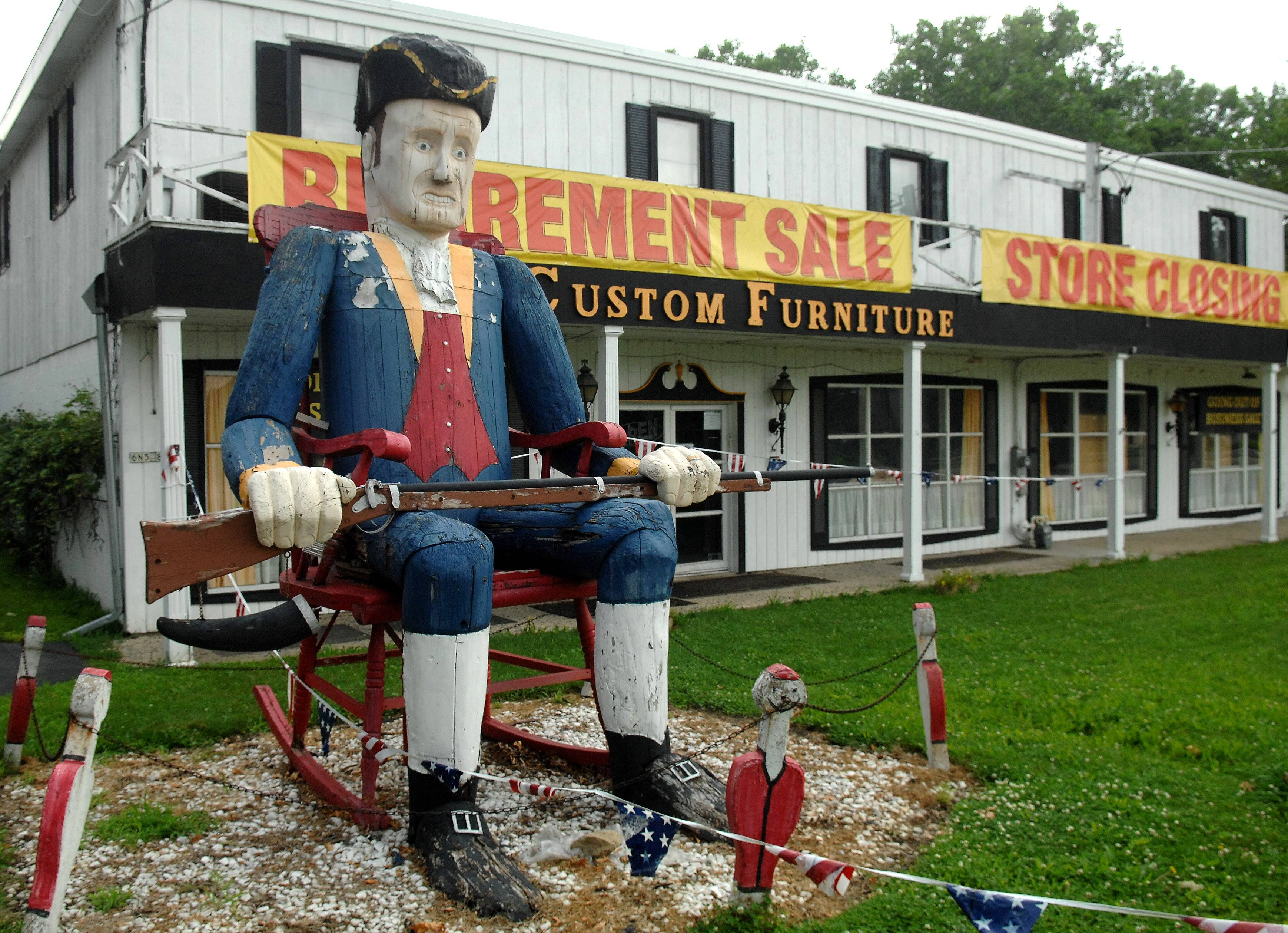 "Wyman ""Clint"" Carey of Pingree Grove bought the 25-foot-tall wooden sculpture known as ""The Unknown Soldier,"" which for the last 38 years has sat in front of Custom Furniture in St. Charles. The store is closing, and Carey plans to restore it and display it by his barn."