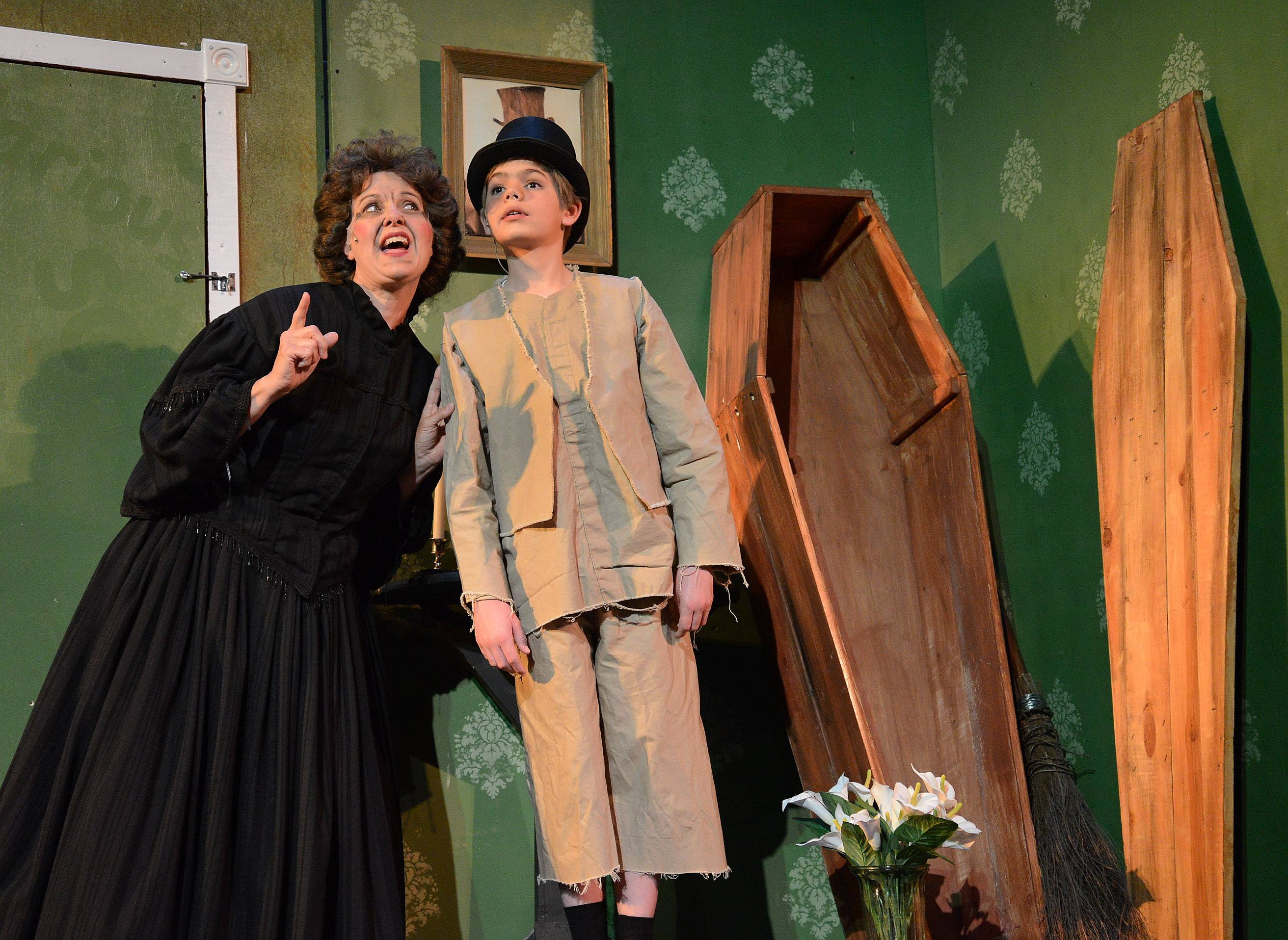 Nanette Sowa as Mrs. Sowerberry, the undertaker's wife, with young Oliver, played by Benjamin Sanetra.