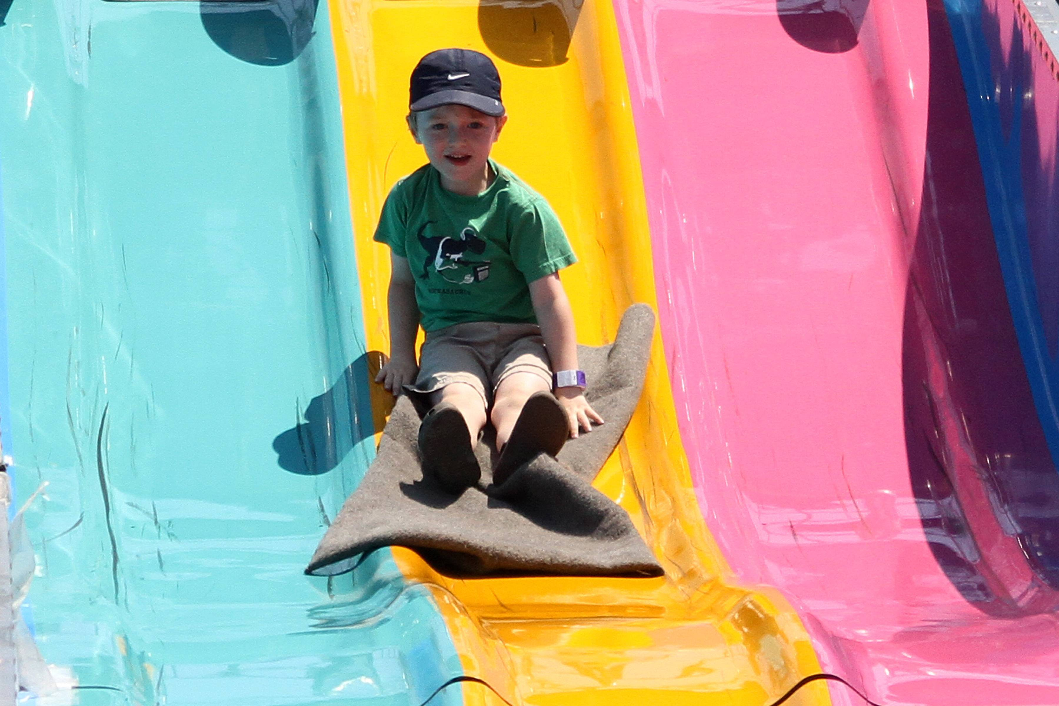 Alastair Parkin, 4, of North Aurora comes down the Fun Slide at the Kane County Fair last year.