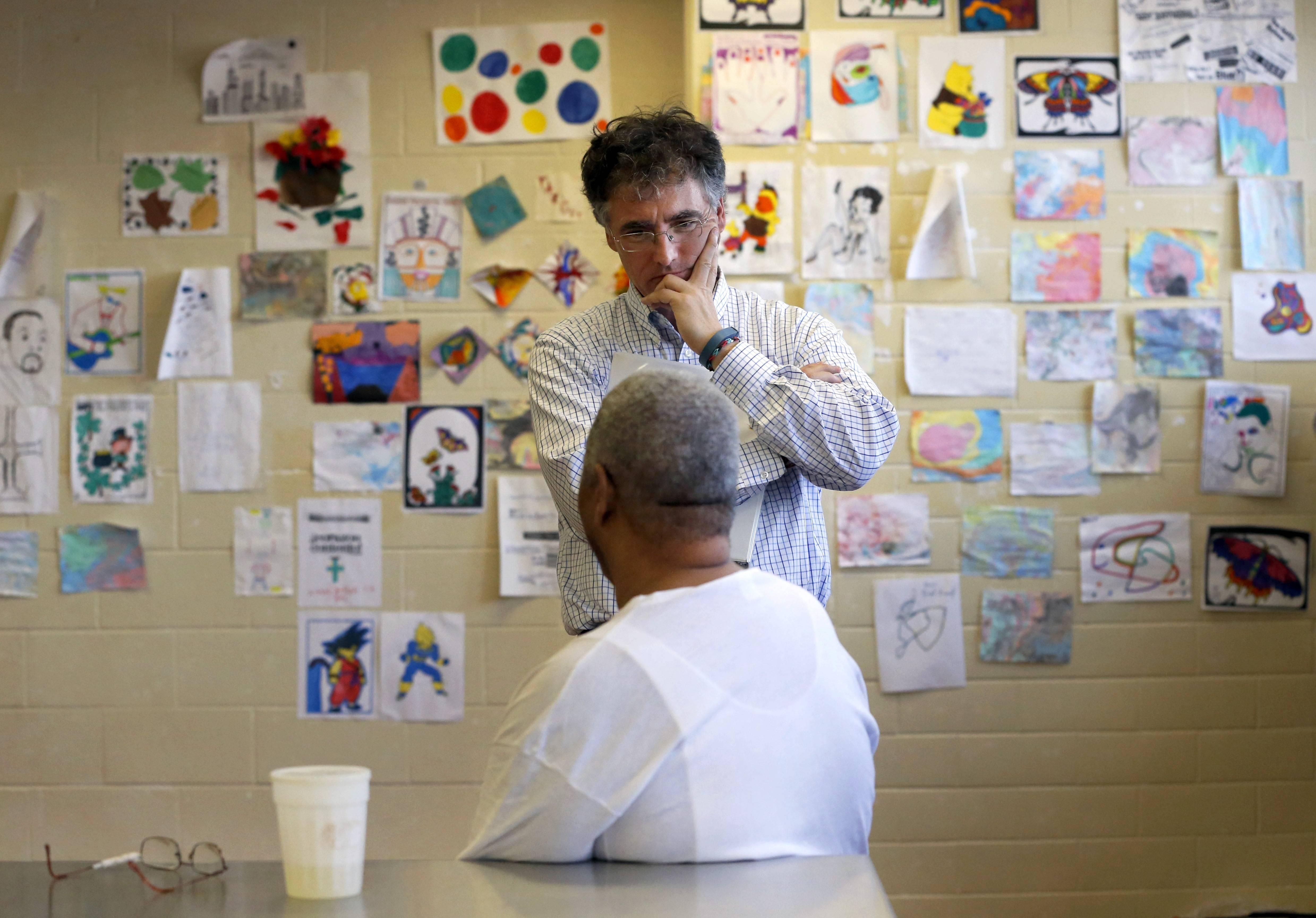 Cook County Sheriff Tom Dart, top, talks with William, an inmate in the Cook County jail. Dart, a former prosecutor and state legislator, said when he took over running the Cook County jail in 2006 he knew little about mental illness in the cell blocks.