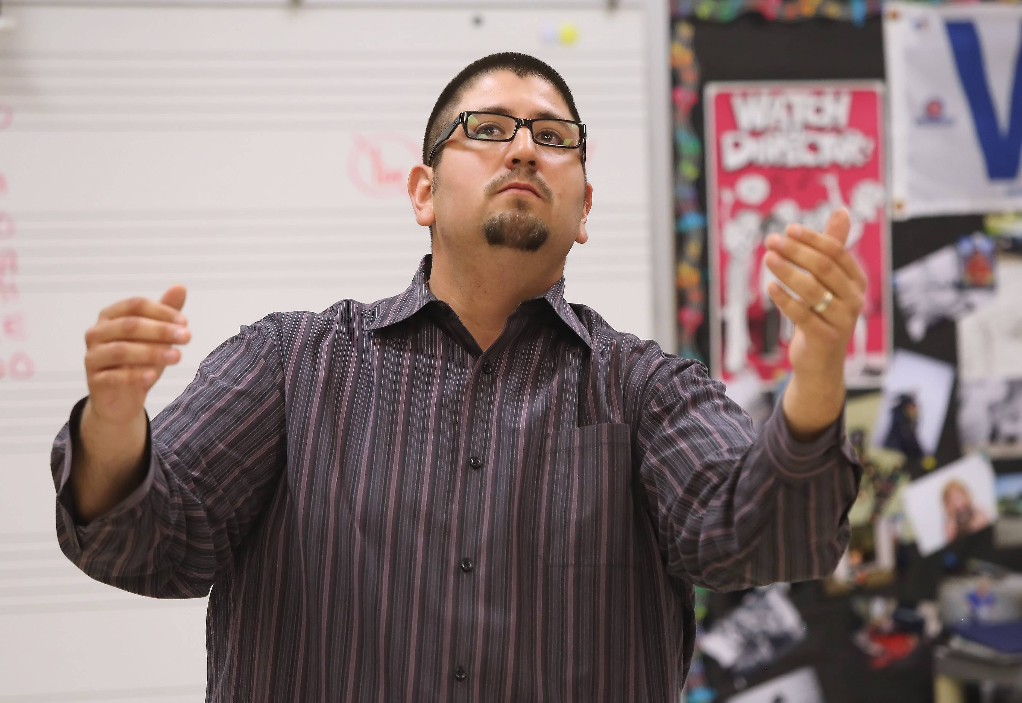 Round Lake Middle School teacher Javier Diaz isn't short on enthusiasm when conducting his choir students.