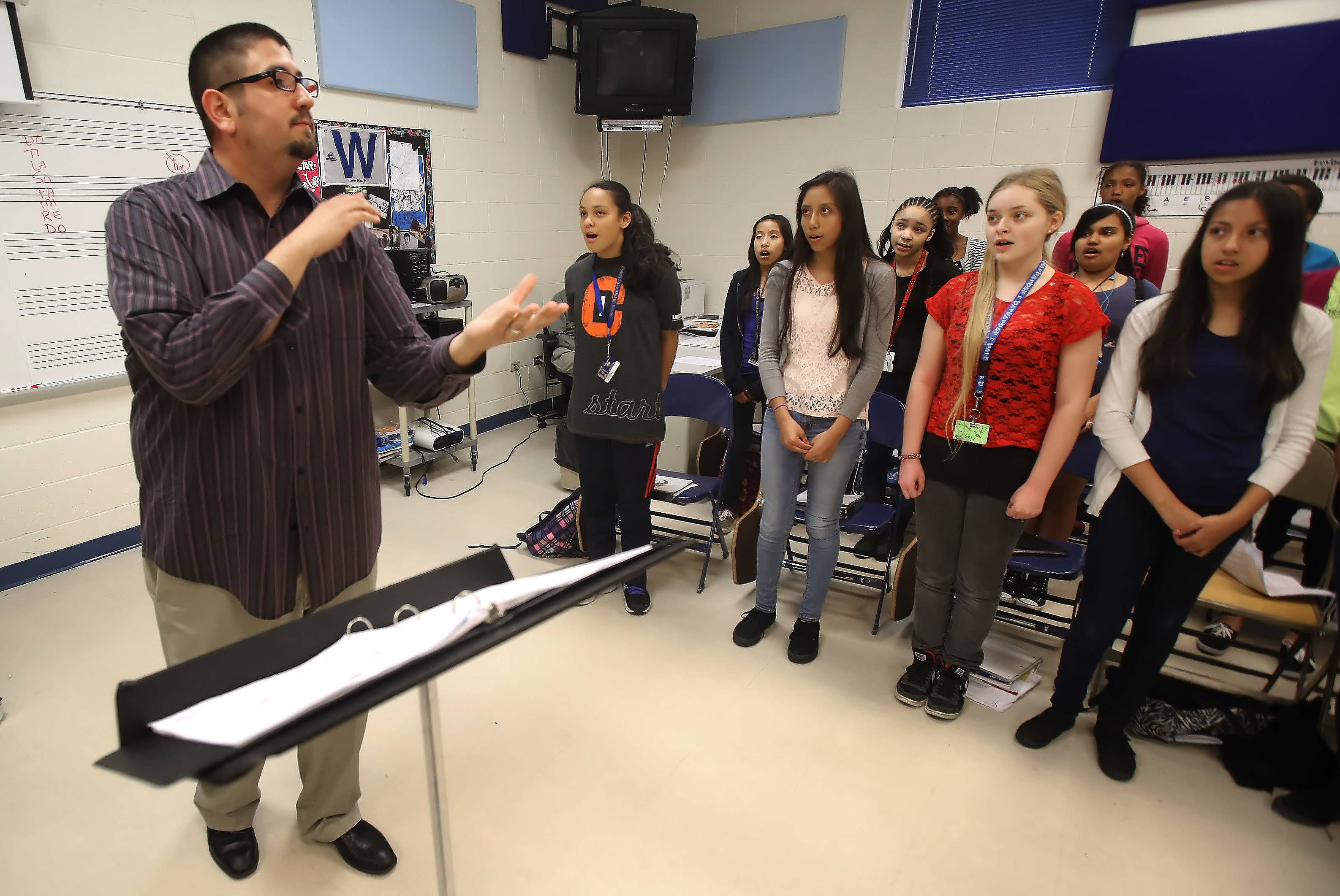 Round Lake Middle School music teacher Javier Diaz has taken the school's choir program from eight students to about 90 in four years.